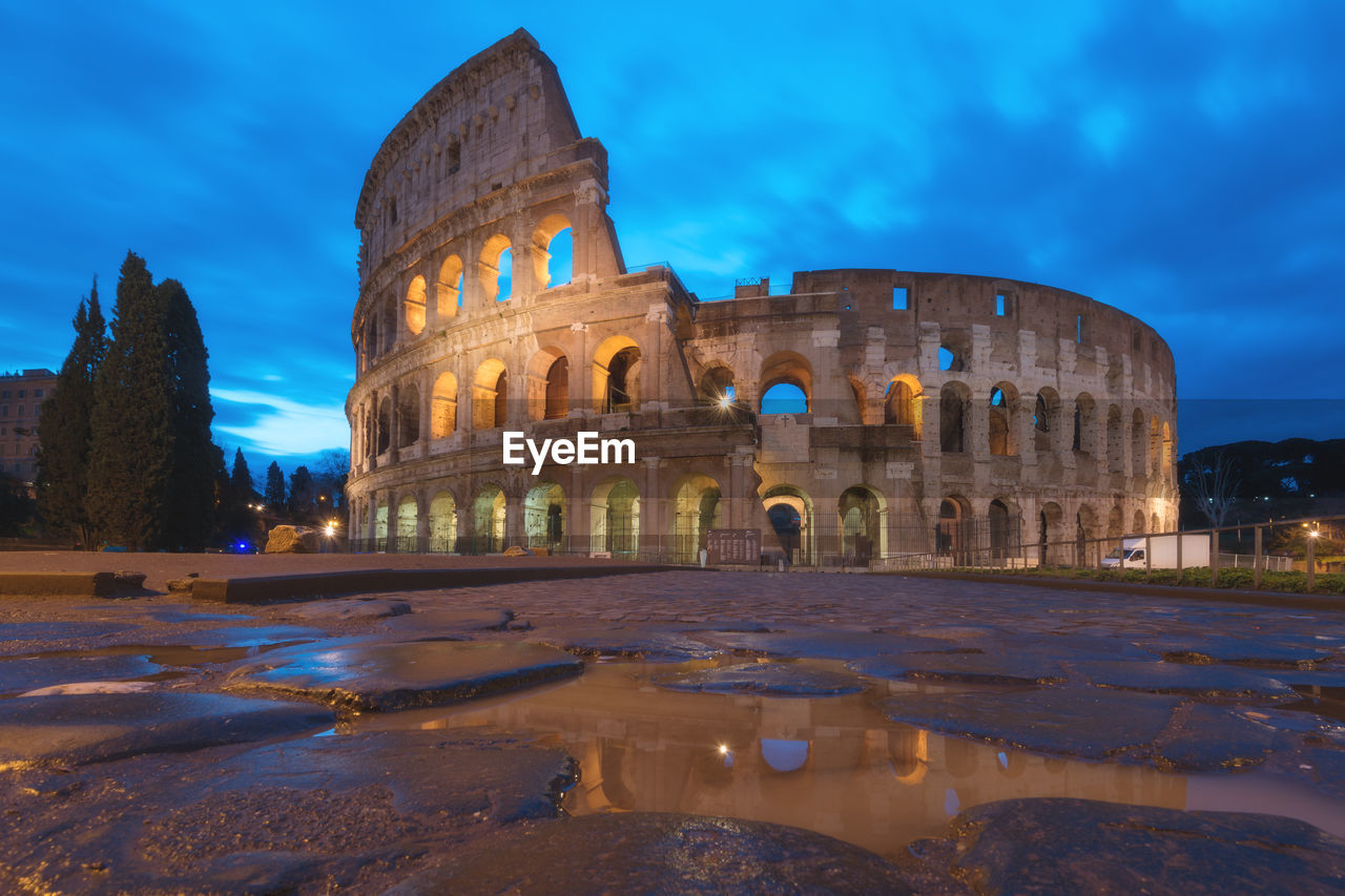 sky, history, architecture, the past, built structure, tourism, travel destinations, arch, ancient, travel, building exterior, cloud - sky, nature, old ruin, ancient civilization, amphitheater, water, no people, arts culture and entertainment, outdoors, archaeology, ruined