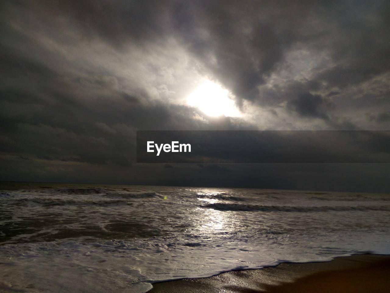 sky, sea, cloud - sky, water, beauty in nature, scenics - nature, land, beach, tranquility, tranquil scene, horizon, horizon over water, nature, no people, storm, overcast, idyllic, non-urban scene, outdoors, ominous