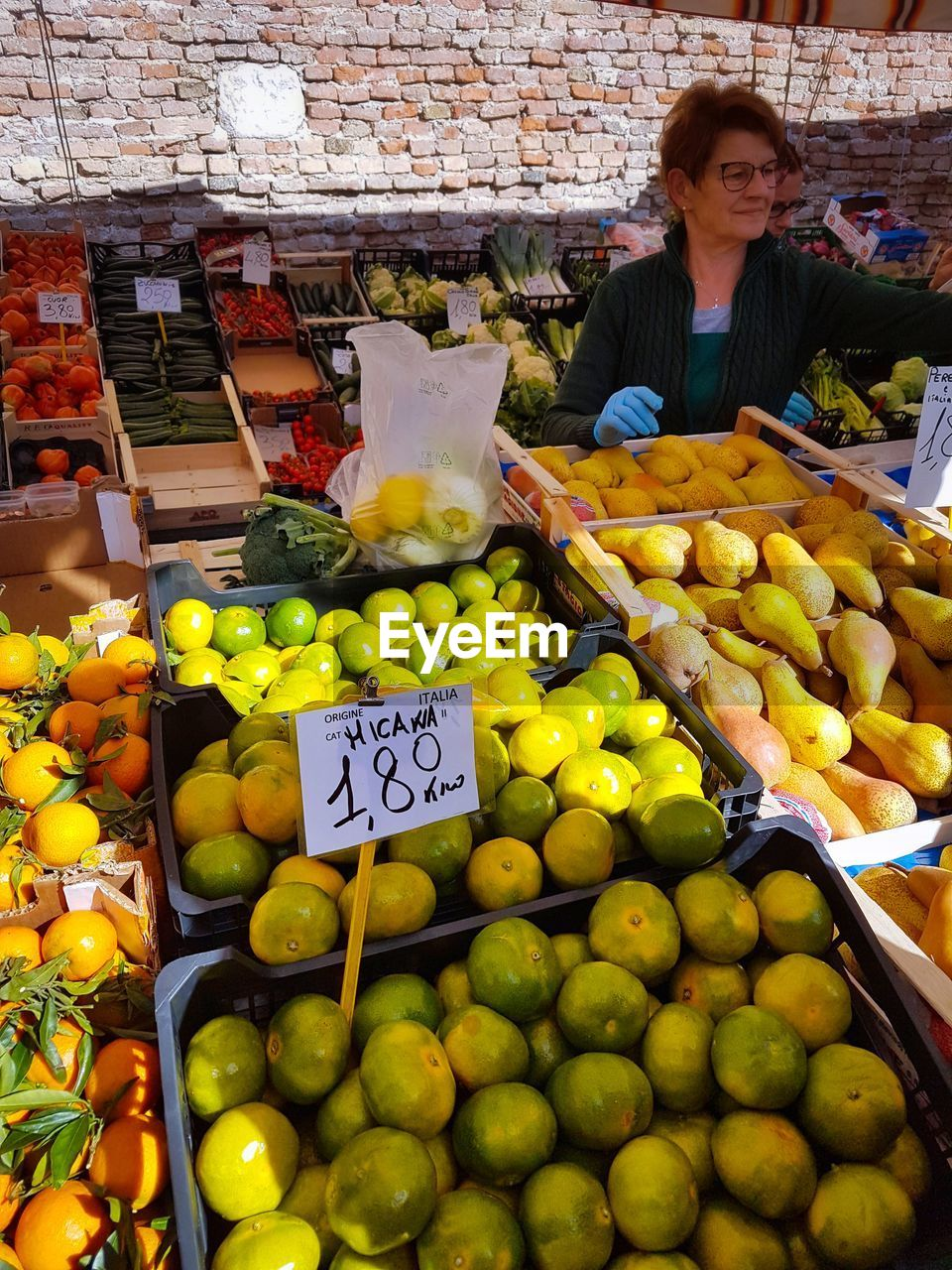 fruit, retail, market, market stall, orange - fruit, healthy eating, for sale, food and drink, freshness, choice, food, large group of objects, small business, variation, abundance, outdoors, citrus fruit, day, one person, business, occupation, price tag, real people, supermarket, people