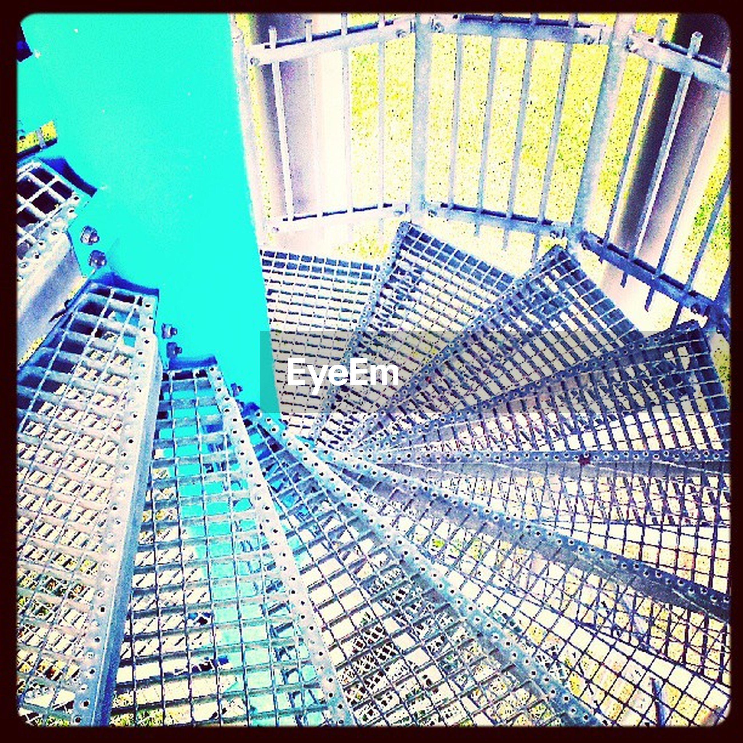 transfer print, auto post production filter, blue, built structure, architecture, sunlight, pattern, shadow, clear sky, building exterior, day, indoors, glass - material, low angle view, railing, modern, steps, geometric shape, tiled floor