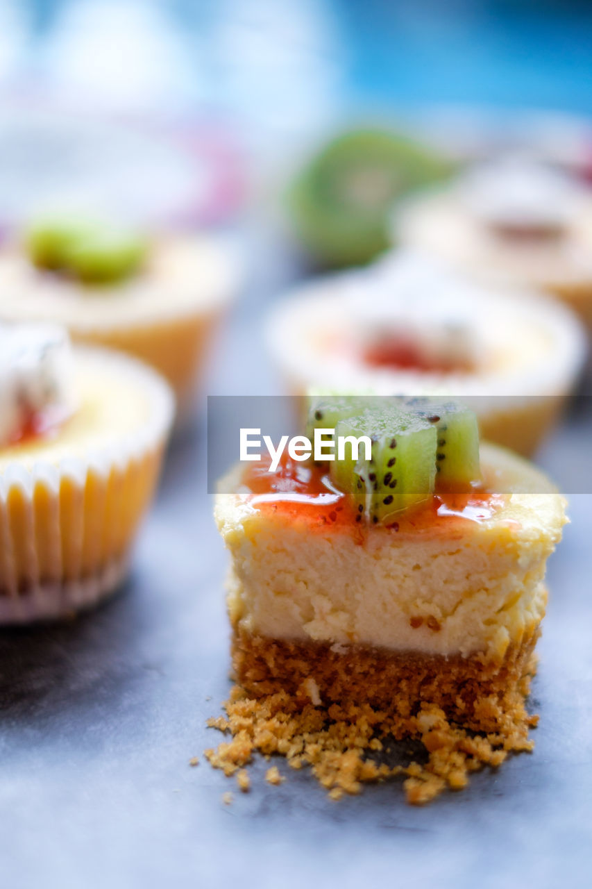 food, food and drink, sweet food, dessert, sweet, temptation, ready-to-eat, freshness, indulgence, cake, baked, still life, selective focus, close-up, no people, indoors, cupcake, plate, focus on foreground, unhealthy eating, baked pastry item, cupcake holder, snack, luxury