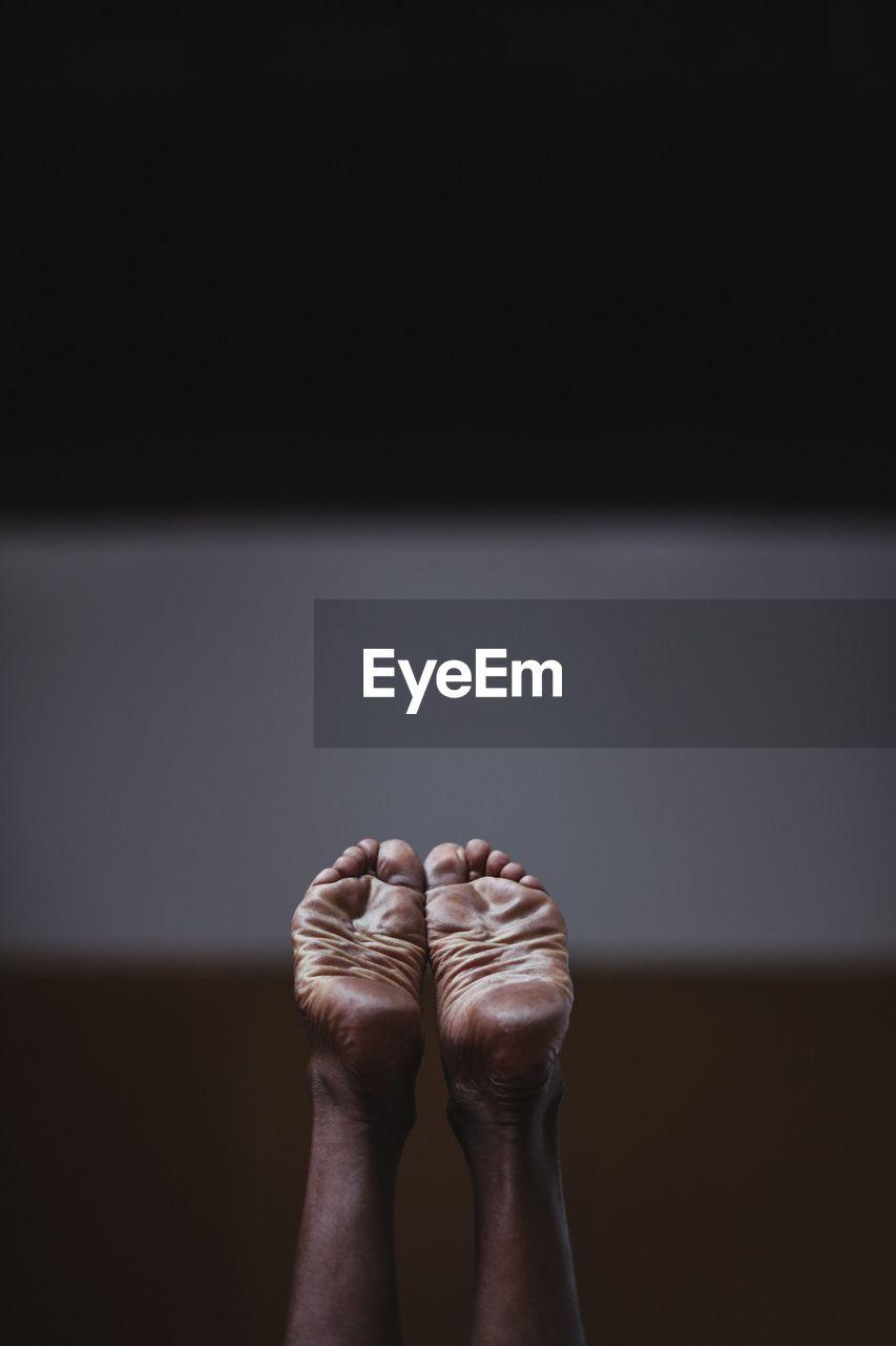 Close-Up Of Bare Feet
