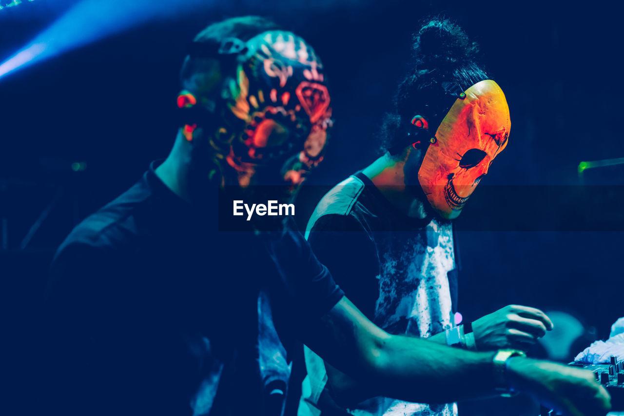 People wearing mask playing music