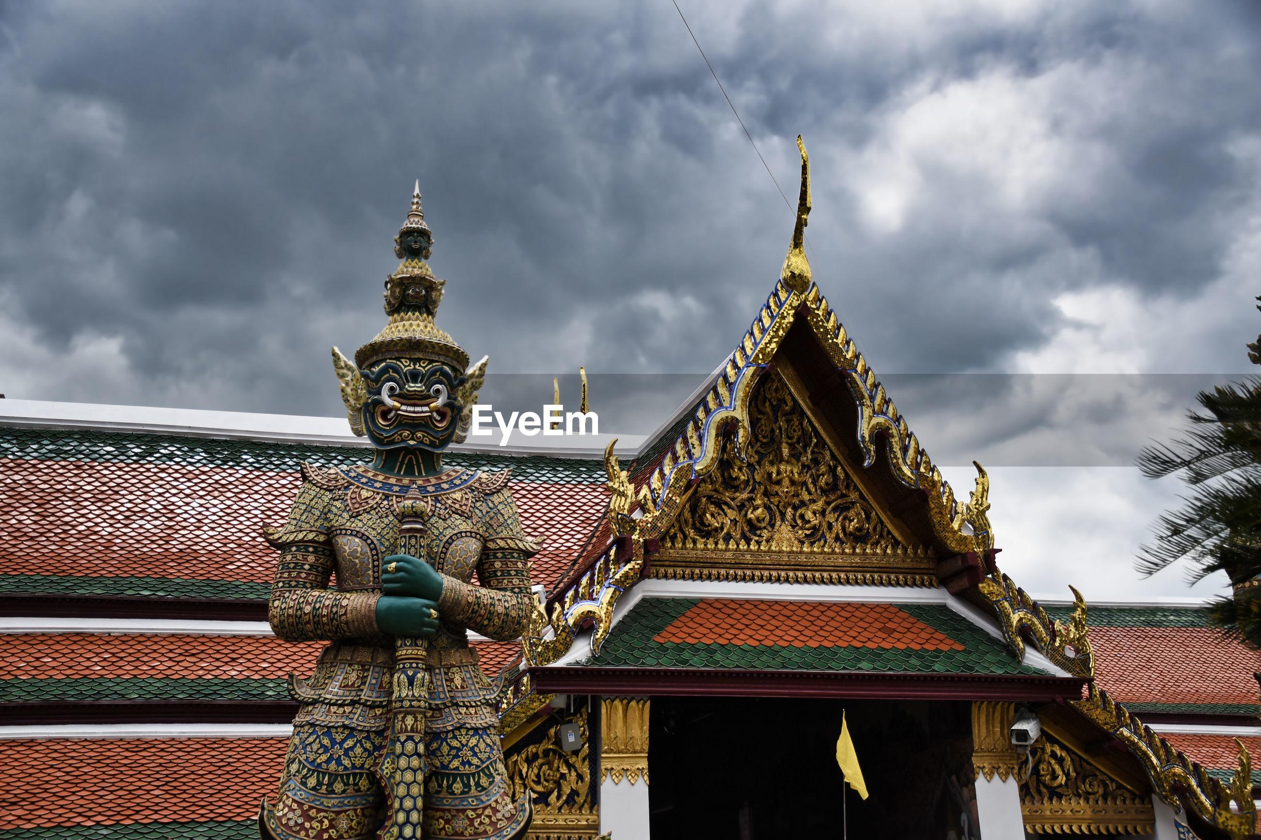 Giant yak, yaksha statue with large teeth, piercing eye with sword in hand