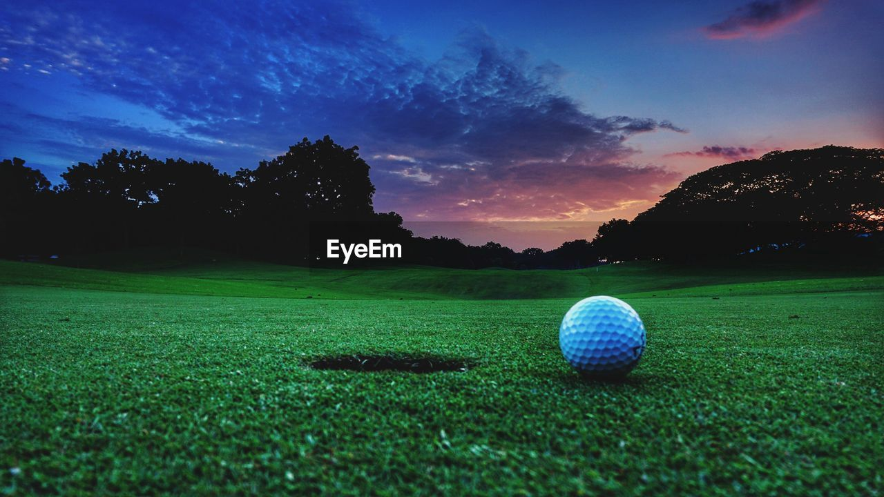 Ball On Golf Course Against Sky During Sunset