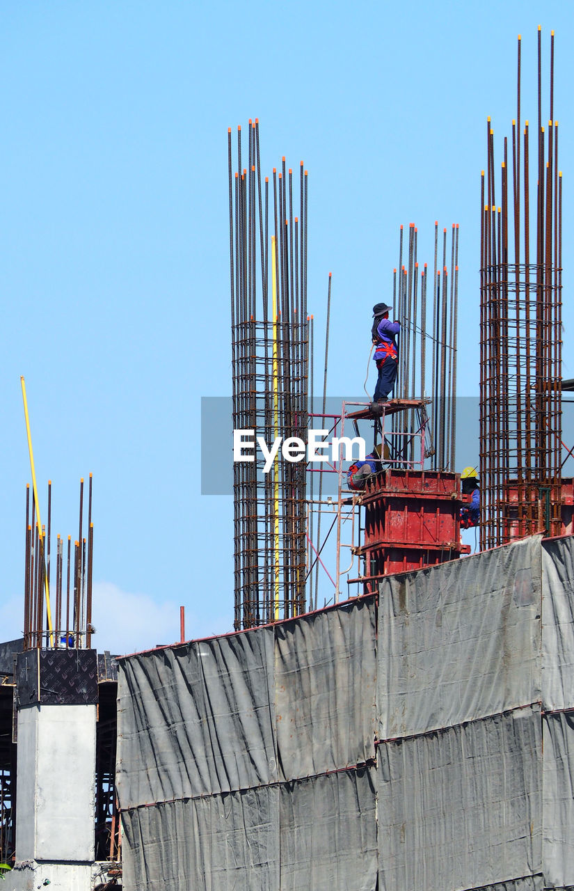 construction site, construction industry, sky, industry, development, architecture, built structure, occupation, working, construction worker, clear sky, day, machinery, incomplete, nature, men, crane - construction machinery, building exterior, metal, outdoors, construction equipment