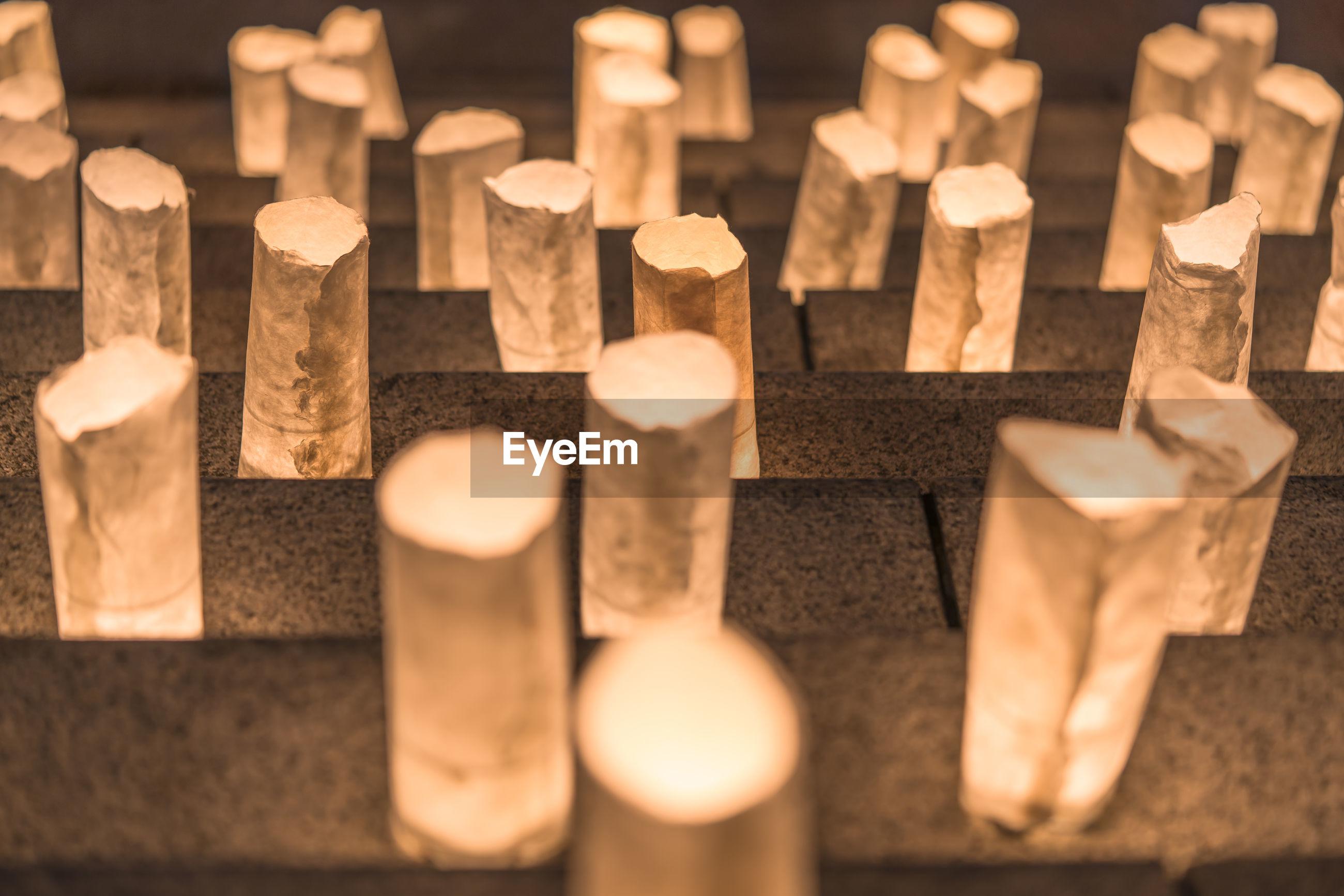 Handmade japanese paper washi lanterns illuminating the stone steps of the zojoji temple.