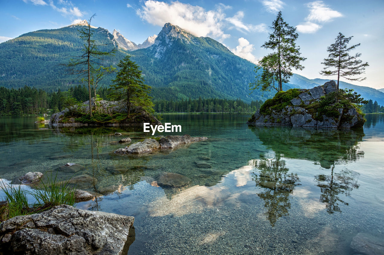 mountain, beauty in nature, reflection, nature, lake, water, tranquil scene, scenics, sky, tranquility, tree, outdoors, day, no people, mountain range