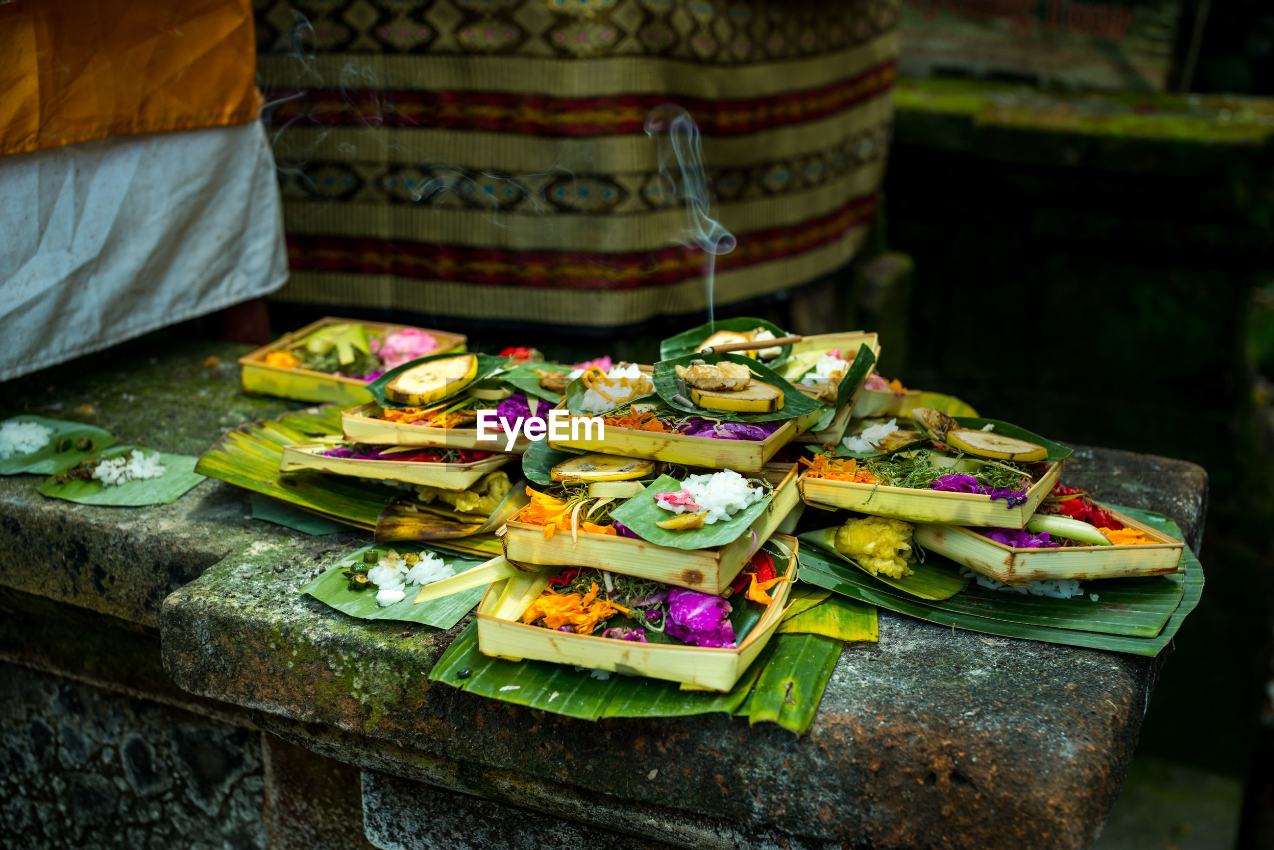 Close-up of religious offering in temple