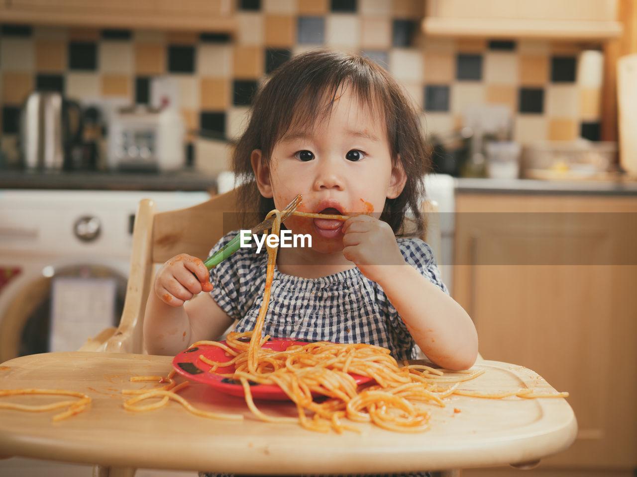 Portrait Of Girl Eating Pasta
