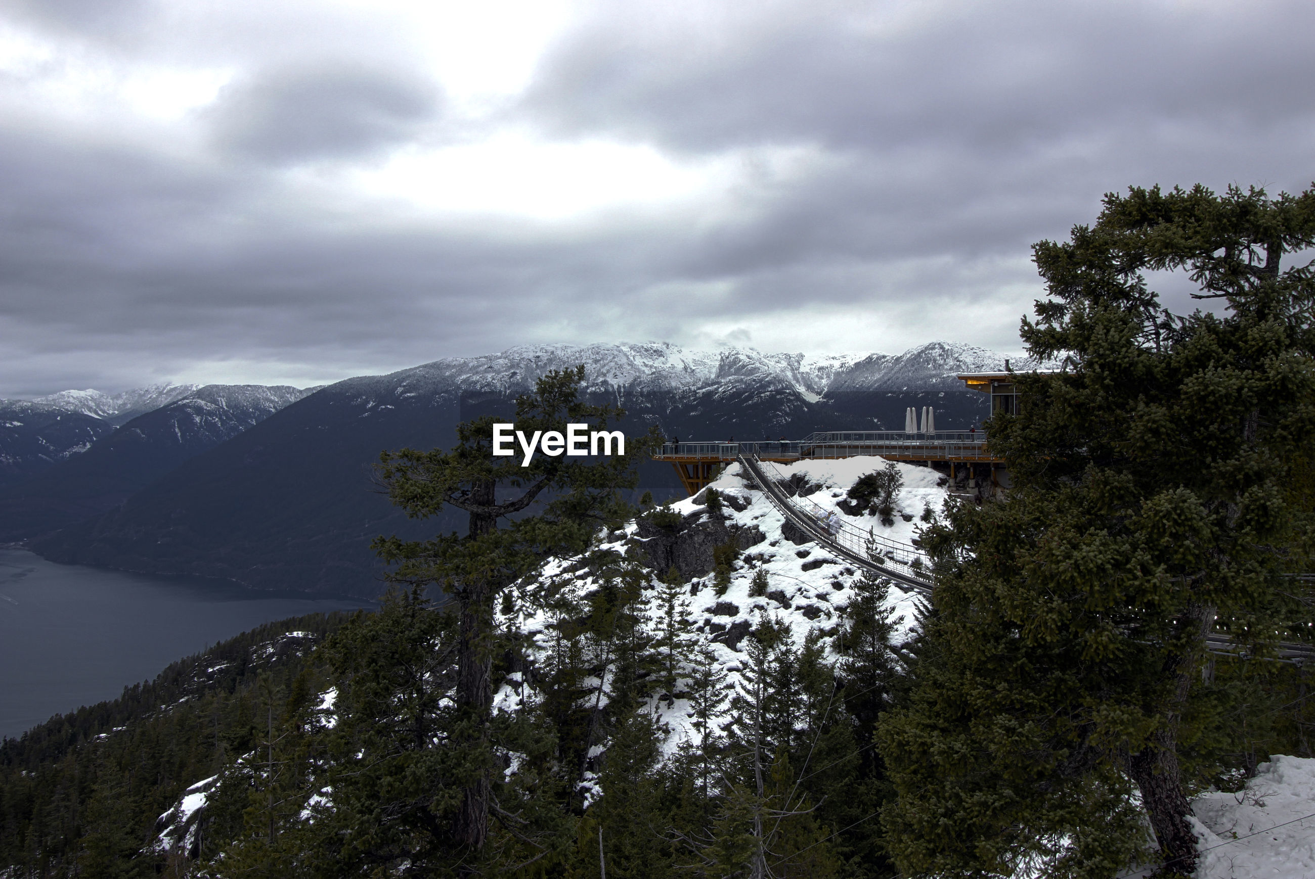 VIEW OF SNOWCAPPED MOUNTAIN AGAINST CLOUDY SKY