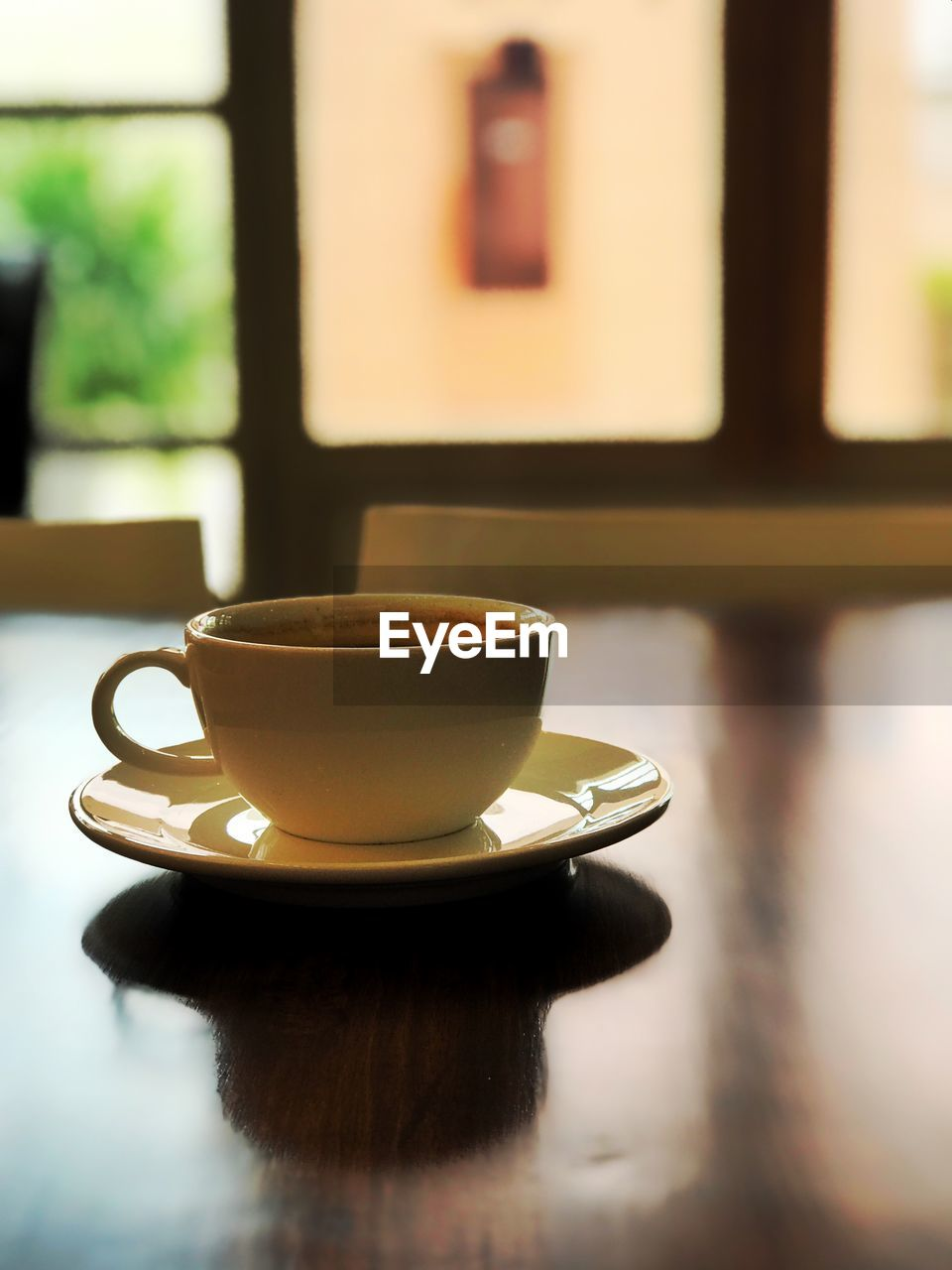 cup, mug, food and drink, drink, refreshment, coffee cup, table, coffee, crockery, coffee - drink, indoors, still life, saucer, hot drink, focus on foreground, freshness, close-up, no people, cafe, tea, tea cup, non-alcoholic beverage