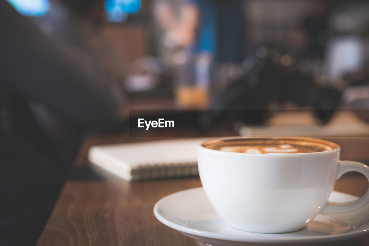 drink, coffee cup, mug, coffee, cup, table, coffee - drink, food and drink, refreshment, crockery, indoors, still life, focus on foreground, saucer, cafe, close-up, hot drink, frothy drink, freshness, cappuccino, latte, coffee shop, non-alcoholic beverage