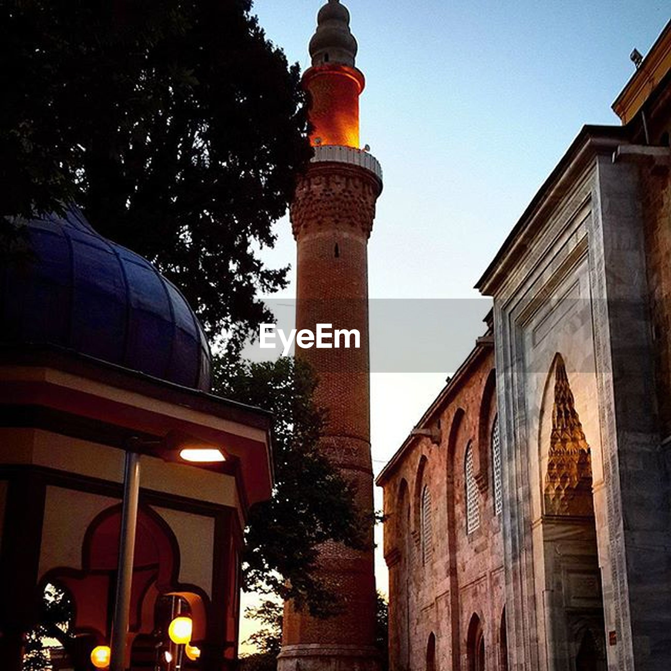 architecture, building exterior, built structure, low angle view, clear sky, sky, history, tower, travel destinations, city, outdoors, exterior, architectural column, no people, street light, illuminated, place of worship, lighting equipment, travel, famous place