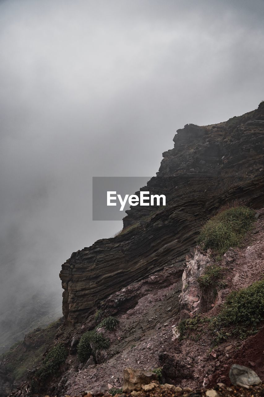 mountain, sky, beauty in nature, rock, scenics - nature, tranquil scene, tranquility, no people, non-urban scene, nature, rock formation, rock - object, cloud - sky, physical geography, day, solid, environment, geology, fog, outdoors, formation, mountain peak, eroded