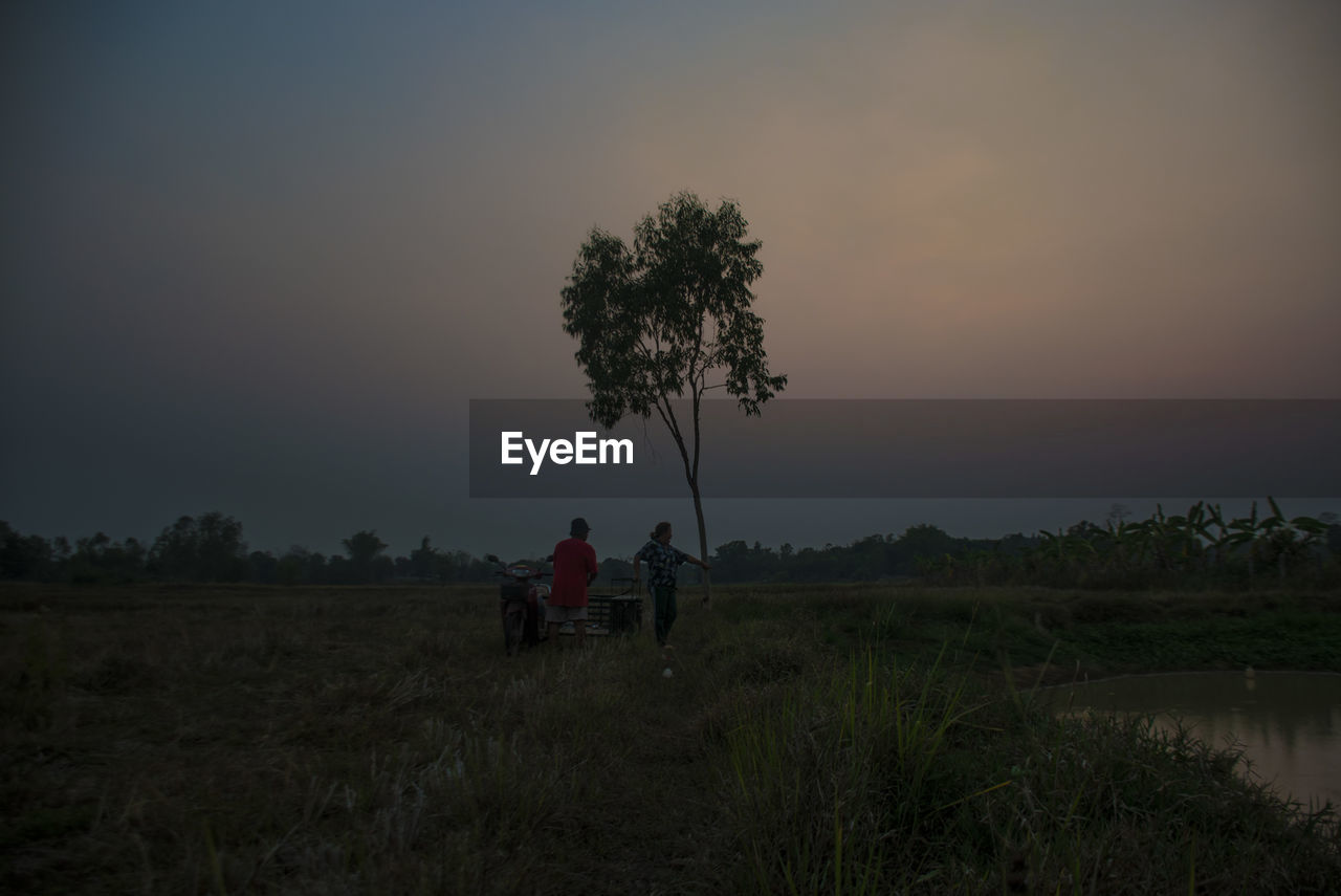 sky, plant, field, two people, land, real people, tree, nature, men, environment, beauty in nature, people, scenics - nature, grass, sunset, transportation, landscape, ride, togetherness, riding, outdoors