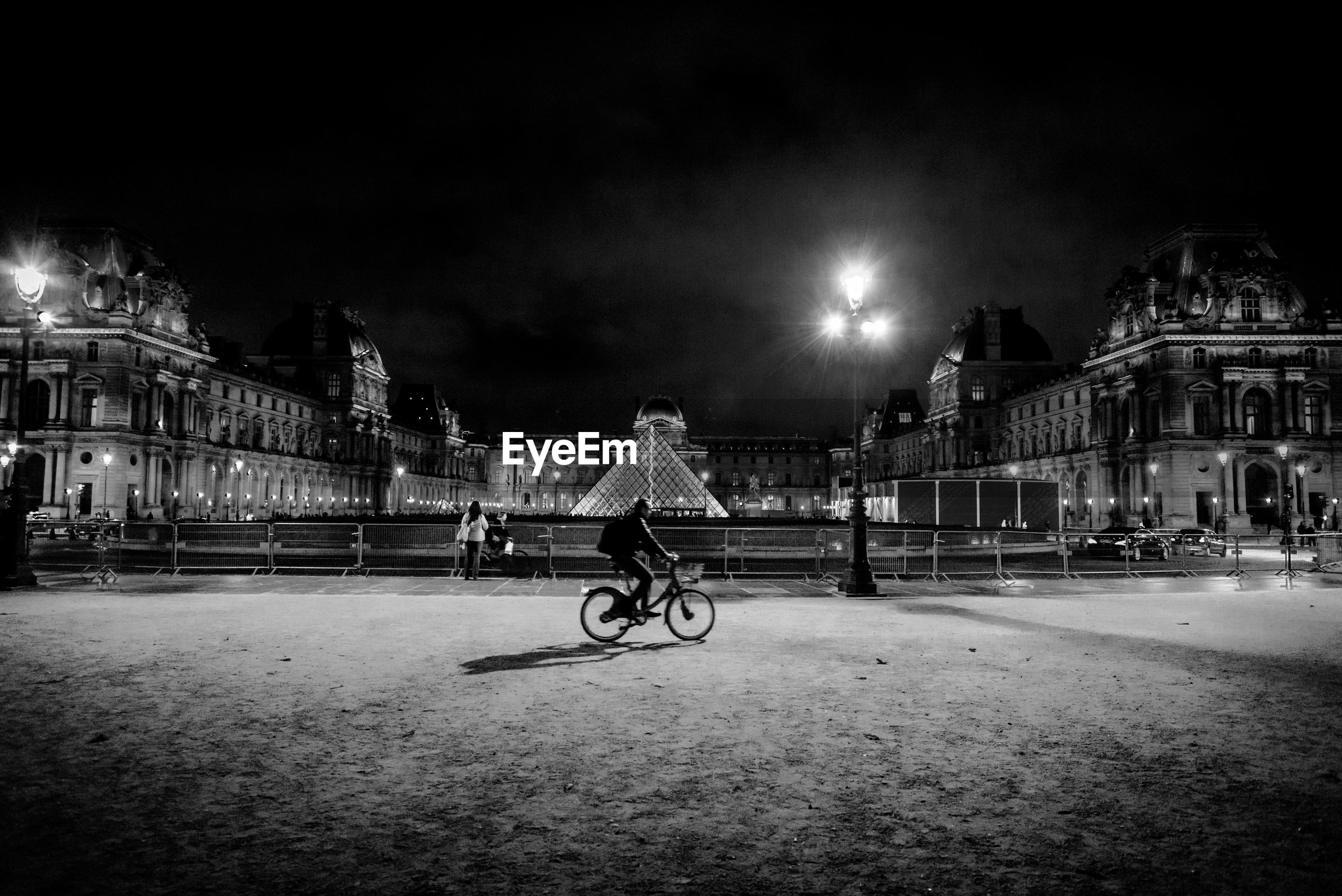 Man cycling on street at night