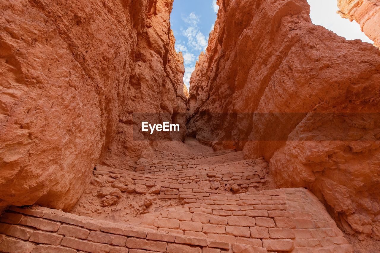 sky, no people, rock formation, architecture, history, the past, rock, solid, nature, rock - object, day, travel, travel destinations, built structure, ancient, tourism, direction, tranquility, the way forward, outdoors, ancient civilization, archaeology, climate, formation