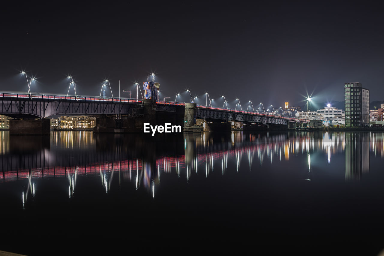 reflection, night, water, built structure, river, illuminated, sky, architecture, waterfront, bridge, connection, bridge - man made structure, no people, nature, building exterior, city, transportation, long exposure, outdoors, nightlife