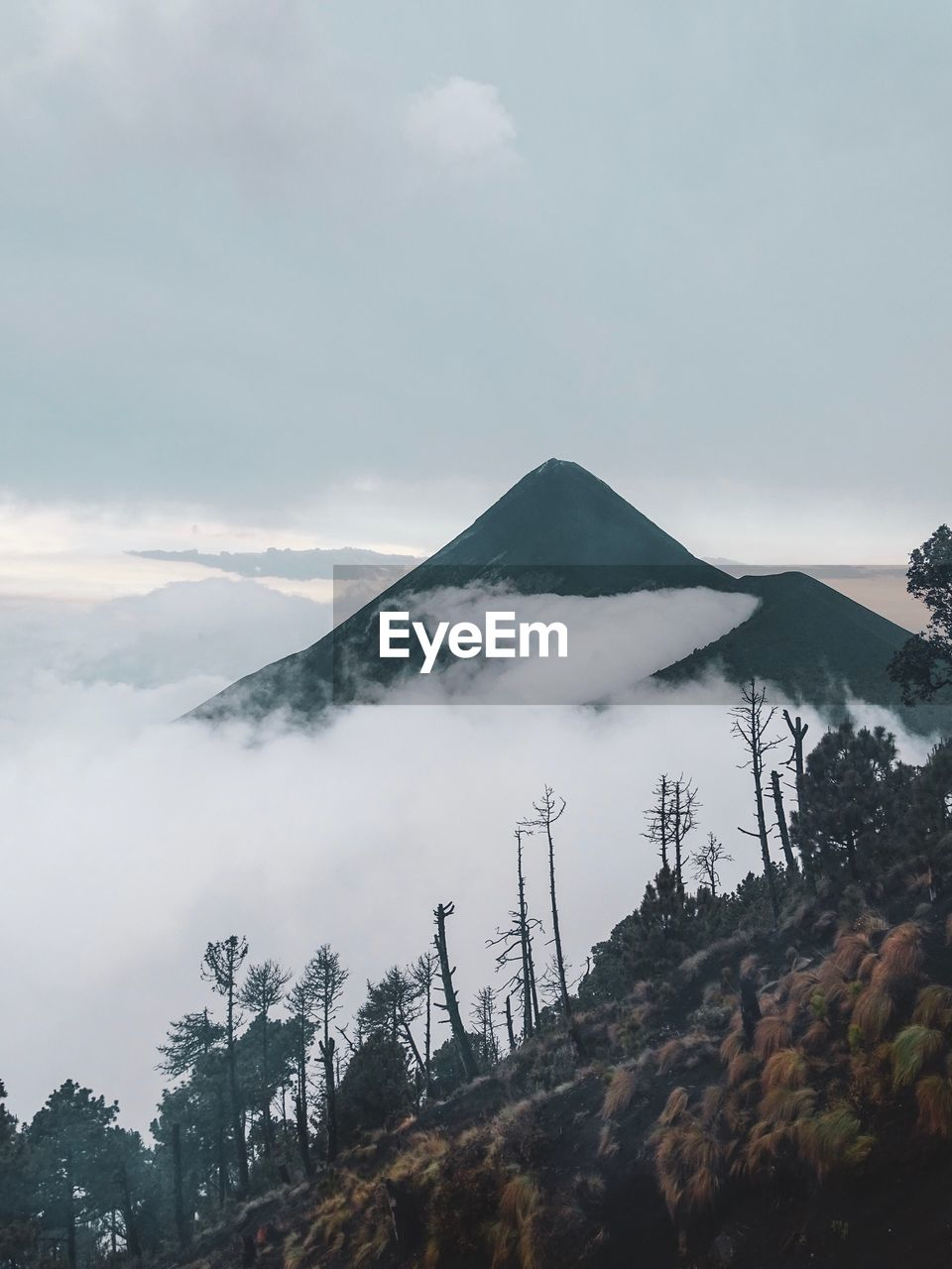 mountain, sky, scenics - nature, beauty in nature, cloud - sky, tranquil scene, tranquility, tree, plant, non-urban scene, nature, no people, cold temperature, winter, volcano, environment, day, smoke - physical structure, snow, mountain peak, mountain range, outdoors, snowcapped mountain, air pollution, volcanic crater
