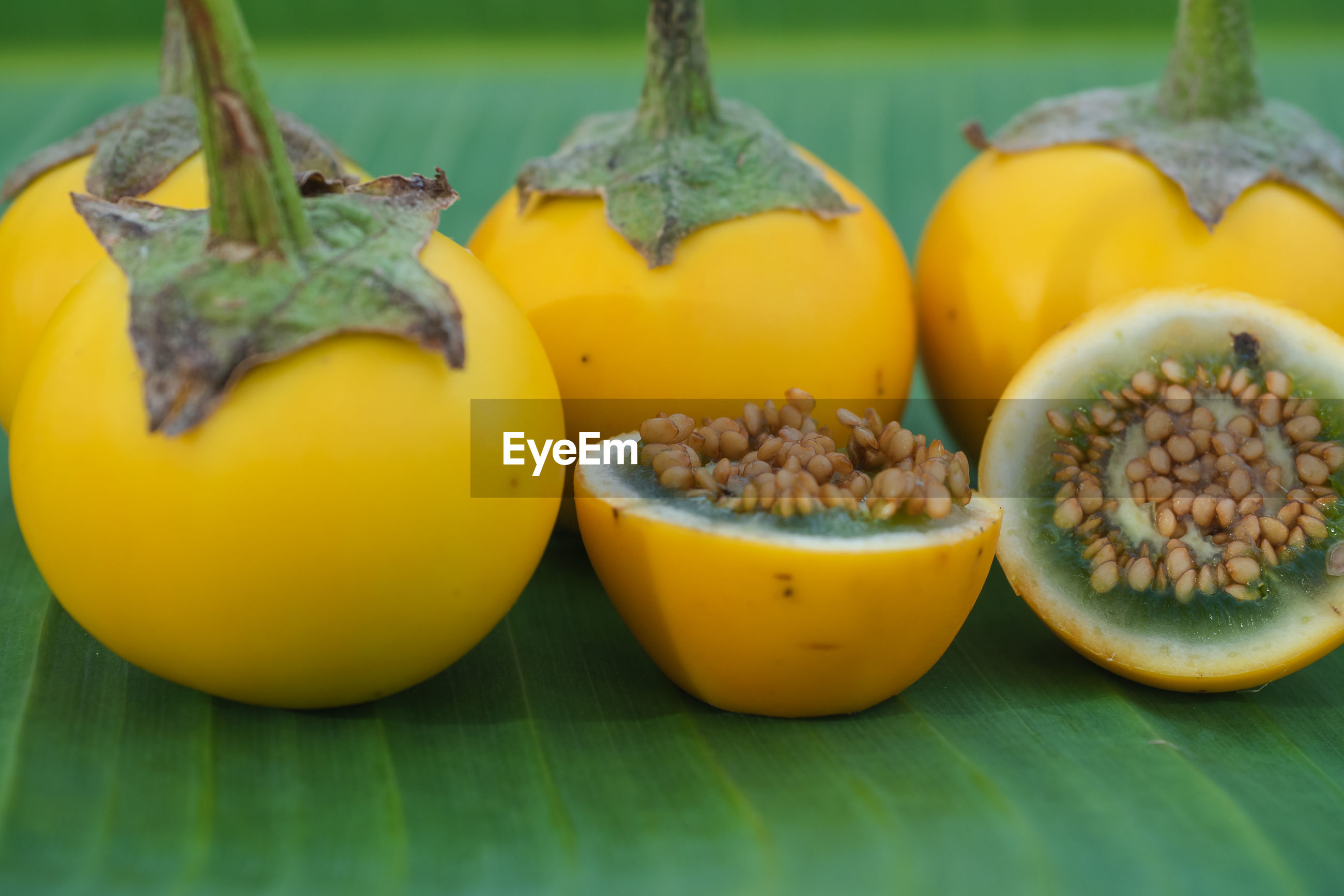 CLOSE-UP OF YELLOW FRUITS IN PLATE