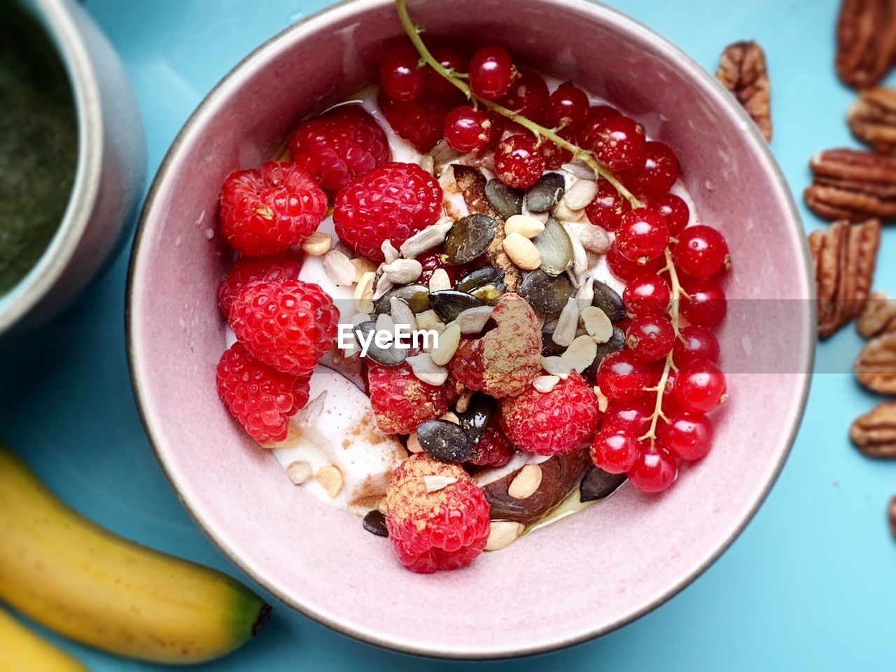 food and drink, food, healthy eating, fruit, wellbeing, freshness, bowl, berry fruit, table, breakfast, still life, meal, raspberry, breakfast cereal, directly above, close-up, indoors, ready-to-eat, high angle view, seed, no people, temptation