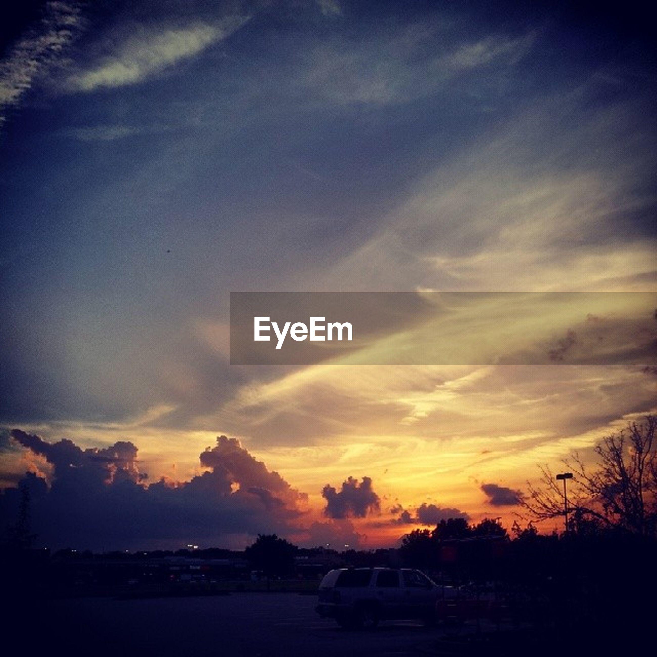 sunset, silhouette, sky, tree, scenics, tranquil scene, tranquility, beauty in nature, cloud - sky, orange color, nature, landscape, idyllic, cloud, dusk, outdoors, dramatic sky, dark, no people, transportation