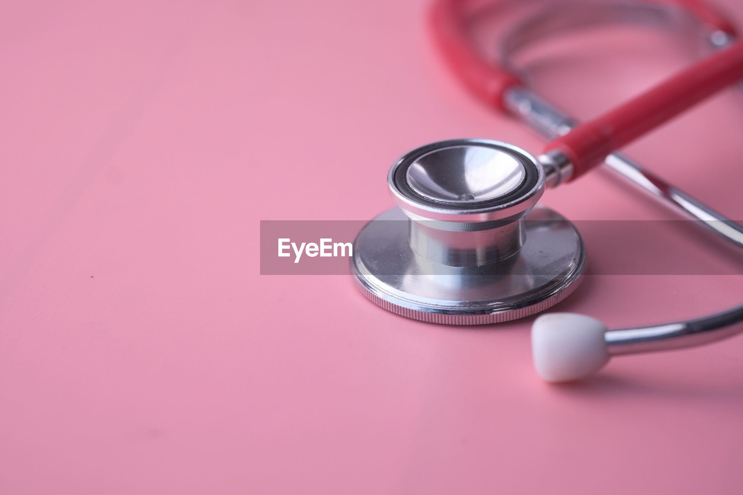 Stethoscope on pink background