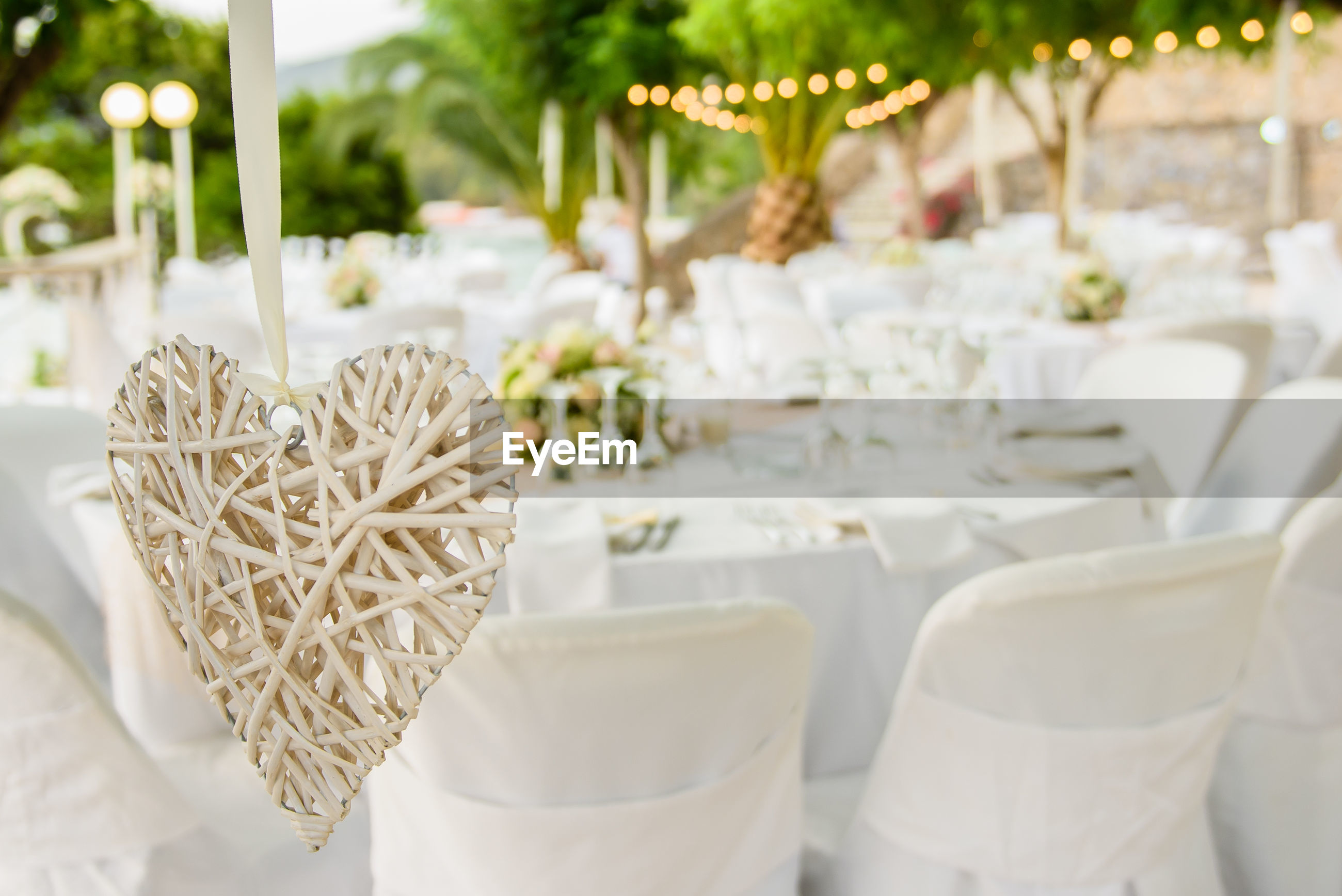 Close-Up Of Heart Shape Against Chairs At Wedding Ceremony