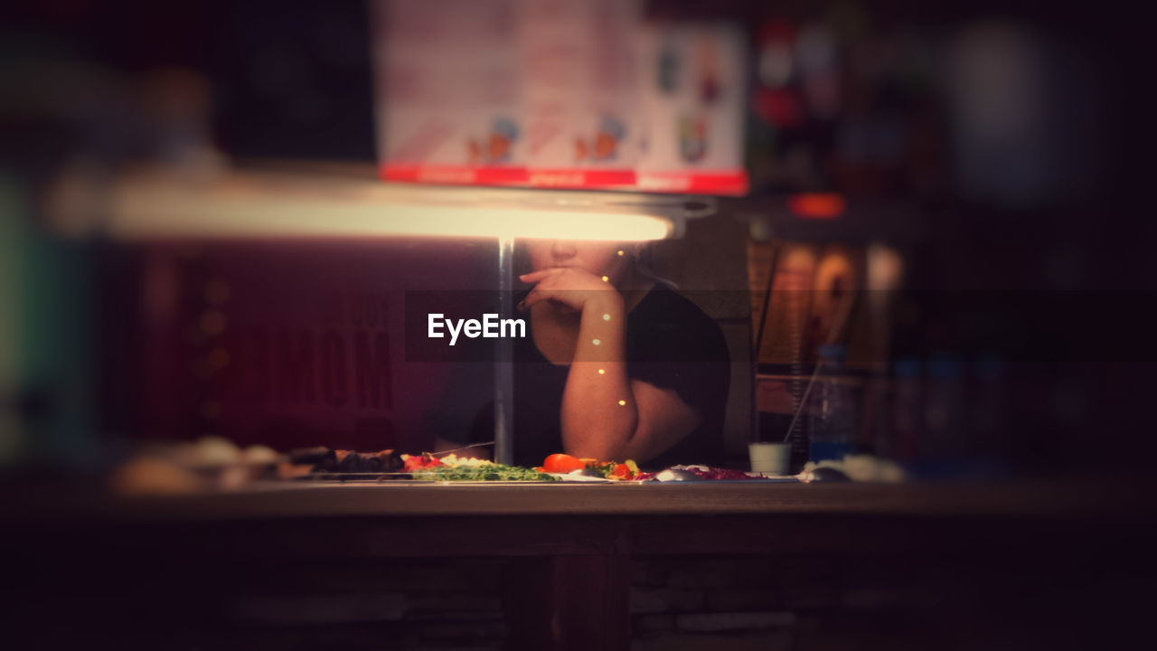 Midsection Of Woman In Restaurant