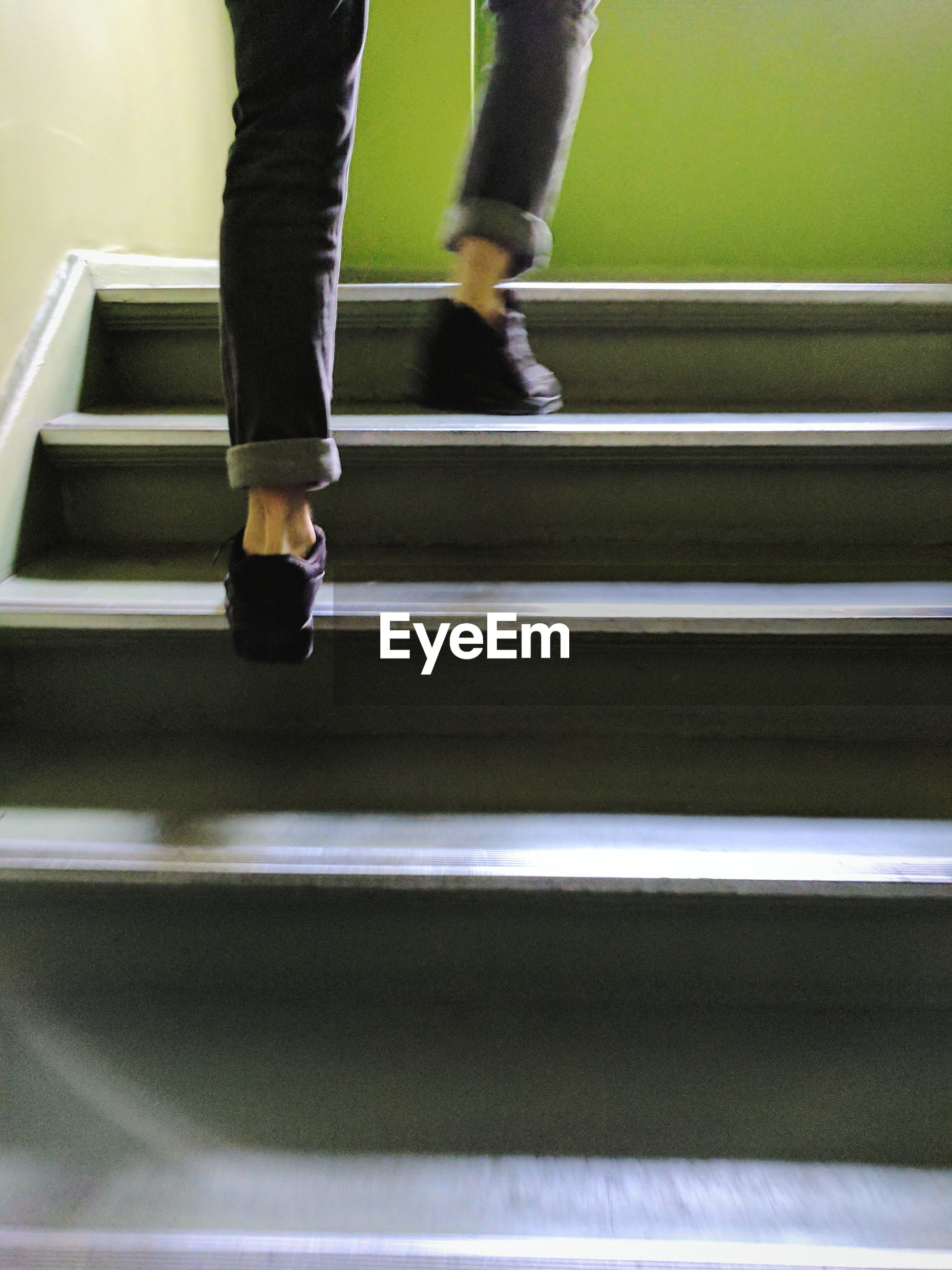 Low section of person moving up stairs