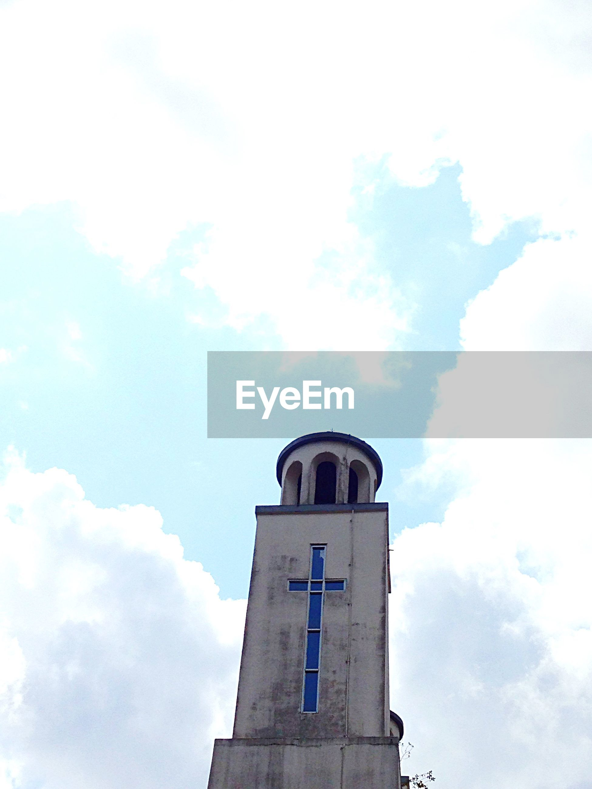 architecture, built structure, building exterior, low angle view, sky, cloud - sky, tower, religion, church, place of worship, history, cloud, cloudy, day, high section, outdoors, arch, spirituality