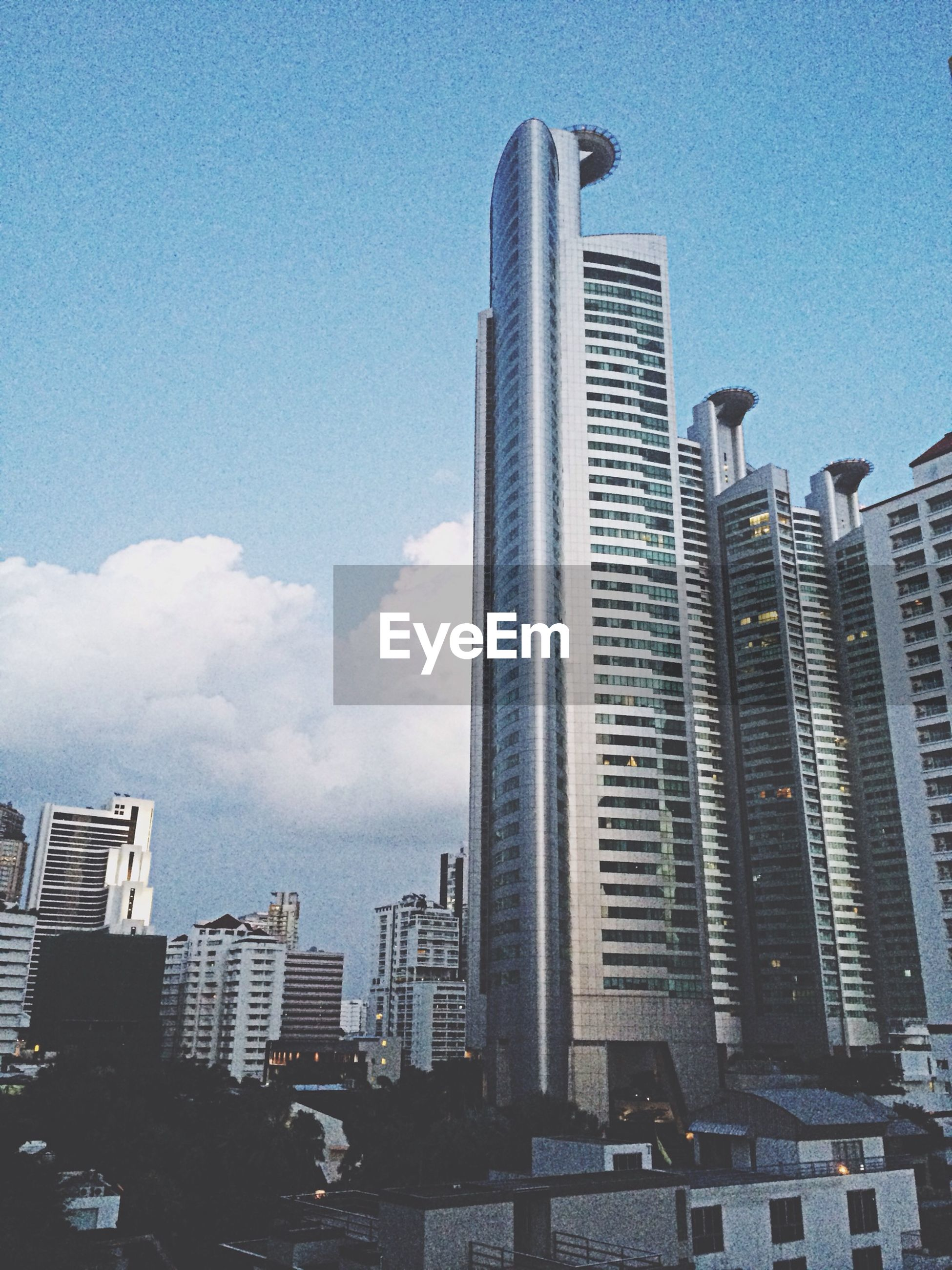building exterior, architecture, built structure, skyscraper, city, office building, tall - high, modern, tower, low angle view, sky, building, financial district, urban skyline, tall, cityscape, city life, blue, day, development