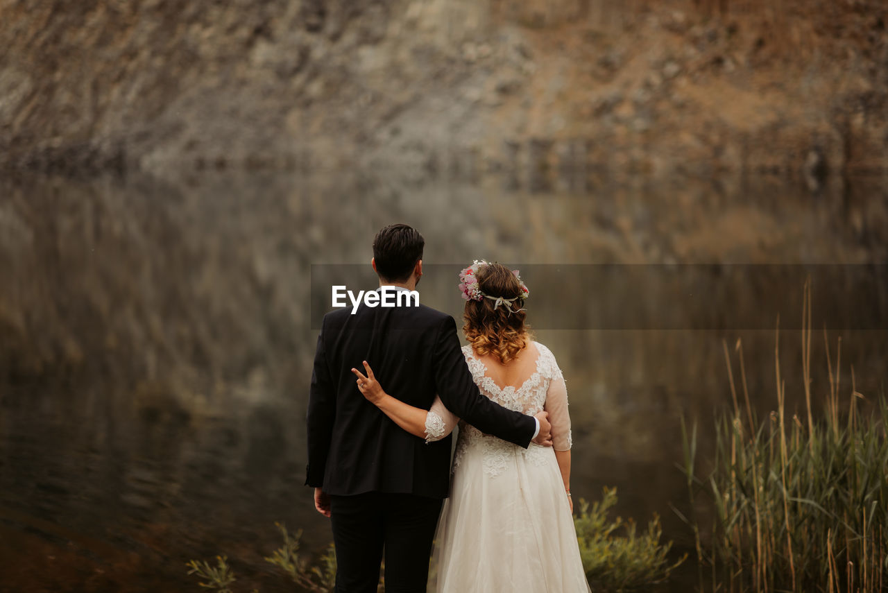 Wedding Couple Standing By Lake