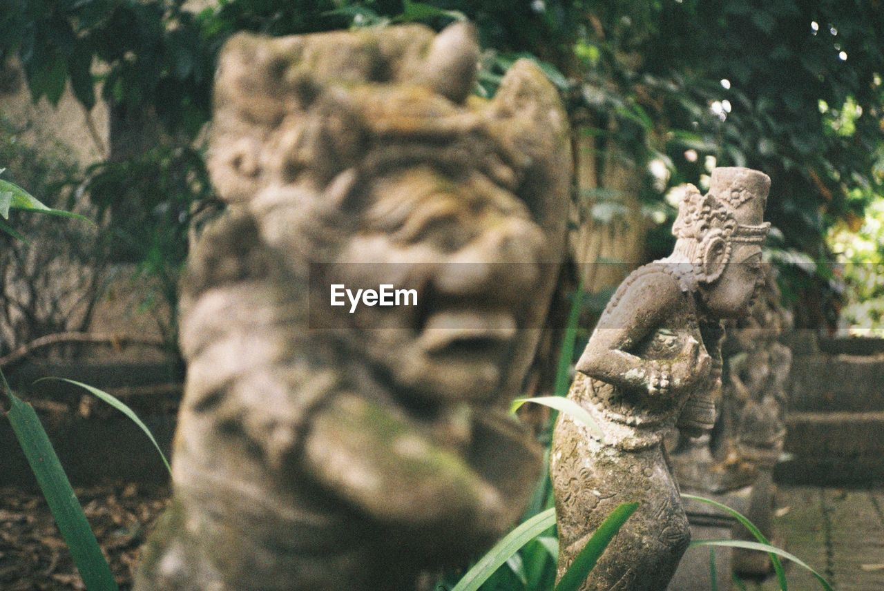 sculpture, statue, representation, art and craft, creativity, craft, human representation, focus on foreground, no people, day, architecture, old, carving - craft product, religion, male likeness, solid, stone material, spirituality, close-up