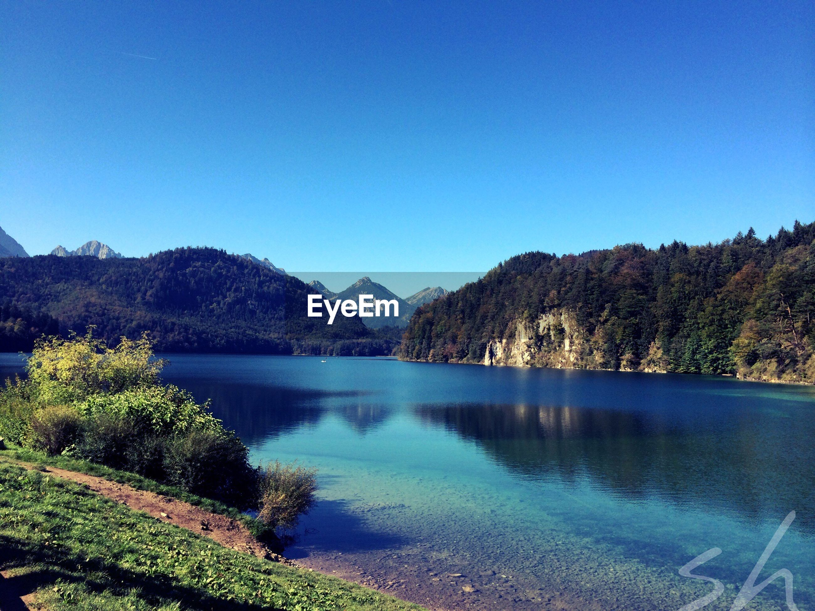 SCENIC VIEW OF BLUE LAKE AGAINST MOUNTAINS