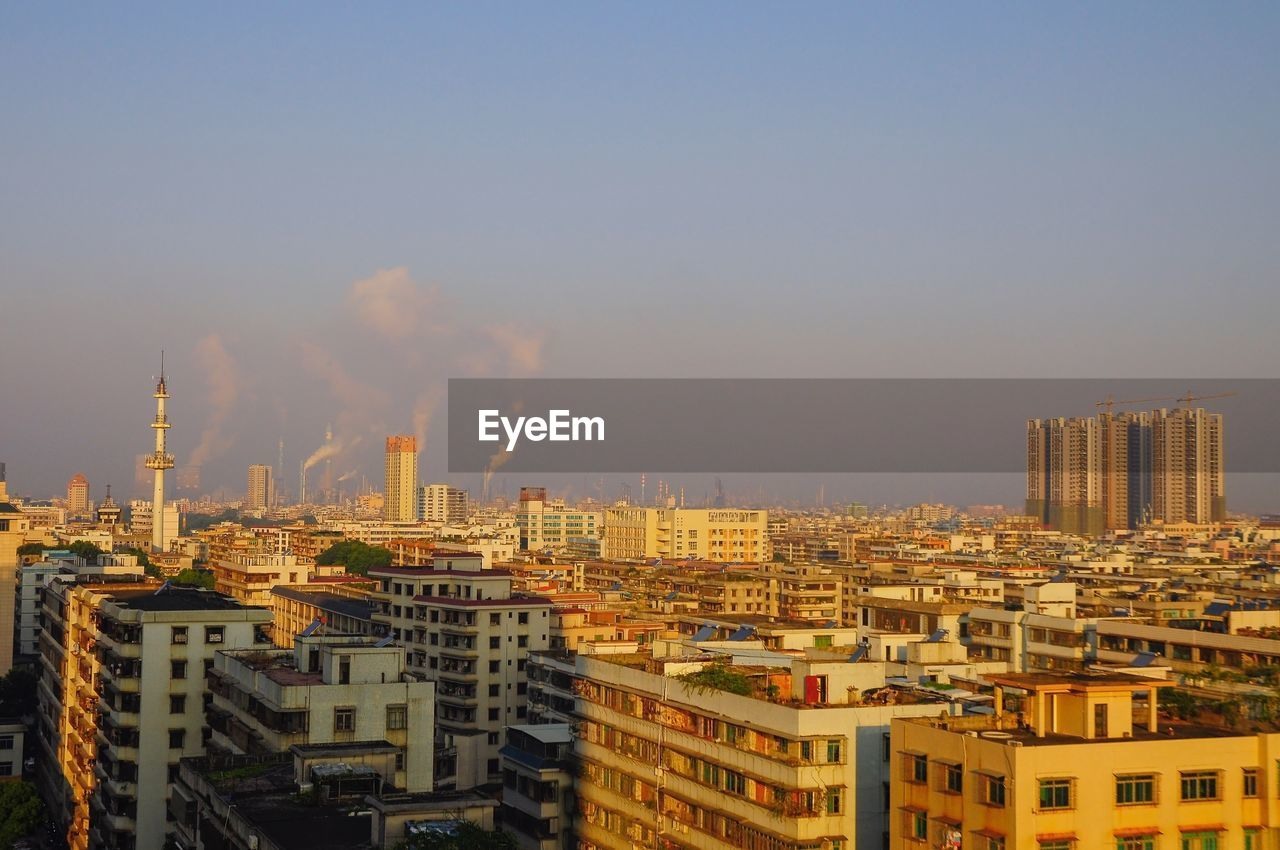 building exterior, architecture, built structure, sky, city, building, cityscape, nature, no people, residential district, tall - high, outdoors, industry, clear sky, day, skyscraper, pollution, sunlight, office building exterior, modern, air pollution, apartment, settlement