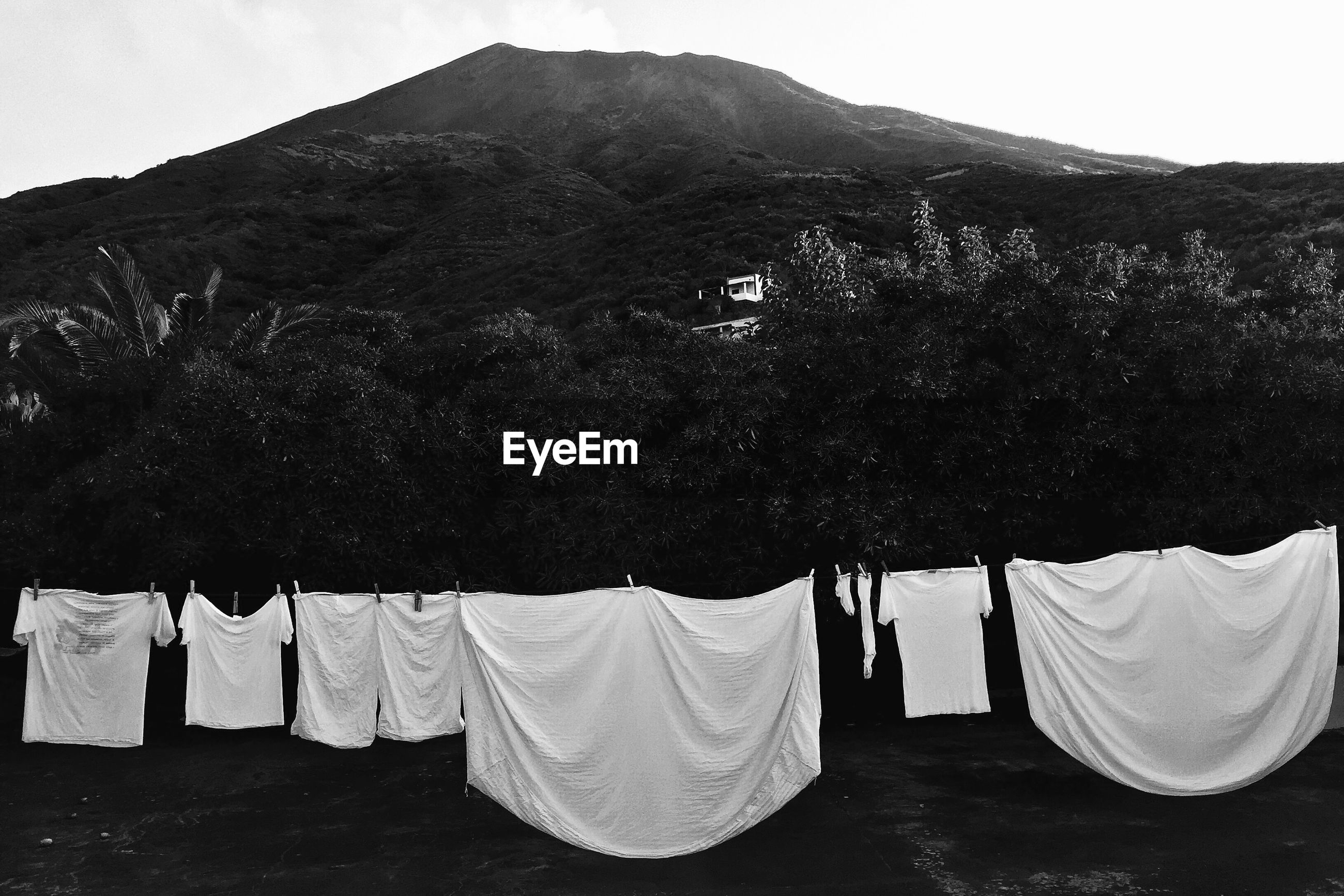 Laundry hanging against mountains