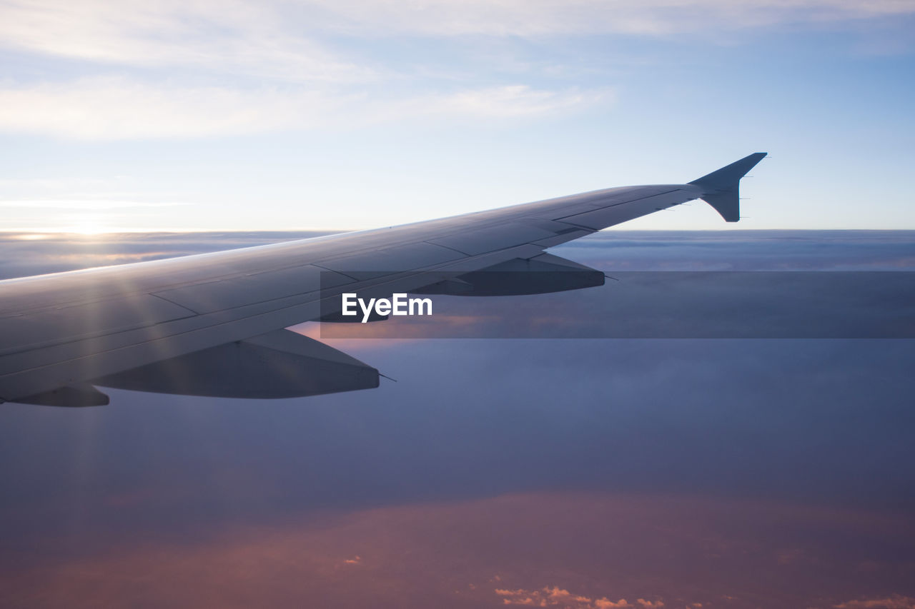 airplane, sky, cloud - sky, airplane wing, journey, transportation, sunset, nature, beauty in nature, no people, aerial view, aircraft wing, air vehicle, scenics, flying, travel, outdoors, day