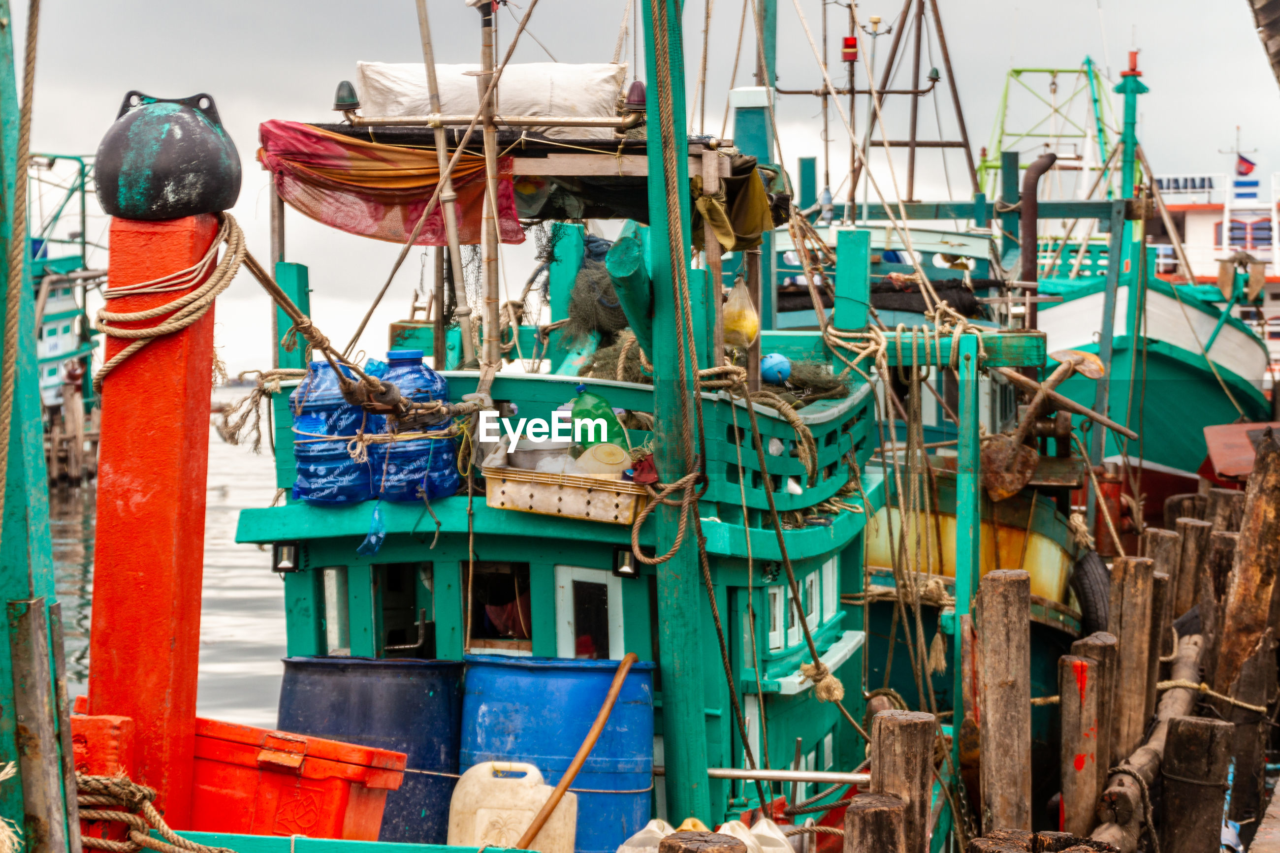 VIEW OF FISHING BOATS MOORED IN HARBOR