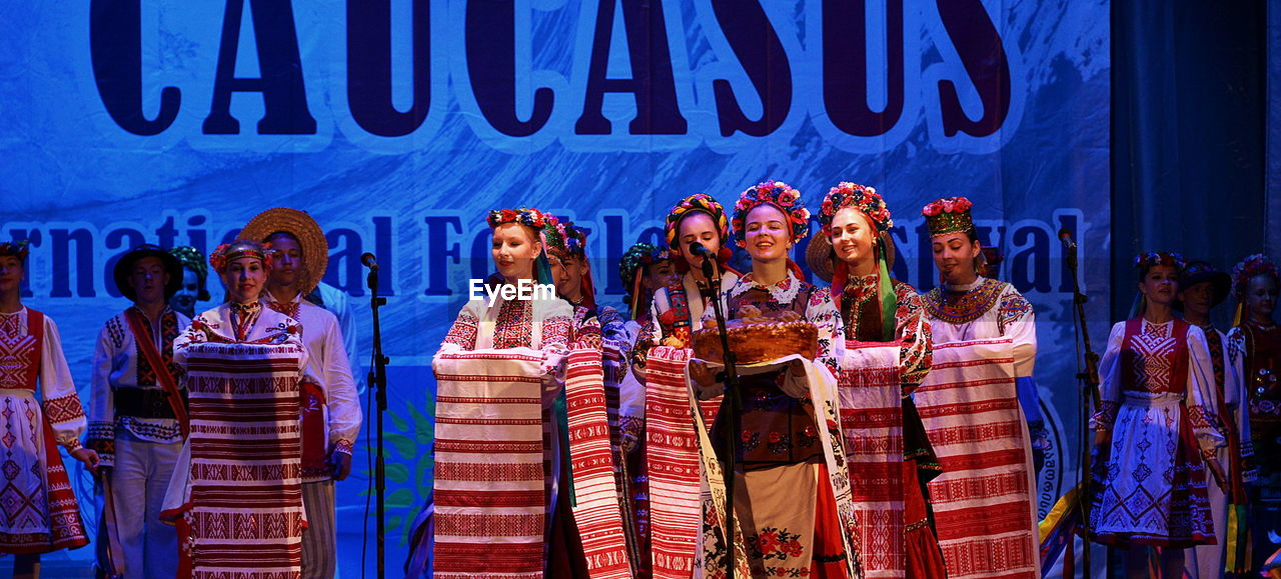 Women in traditional clothing standing on stage