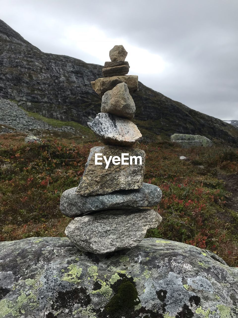 stack, balance, solid, rock, sky, stone, nature, tranquility, stone - object, no people, mountain, beauty in nature, rock - object, zen-like, day, tranquil scene, cloud - sky, environment, landscape, scenics - nature, outdoors, pebble