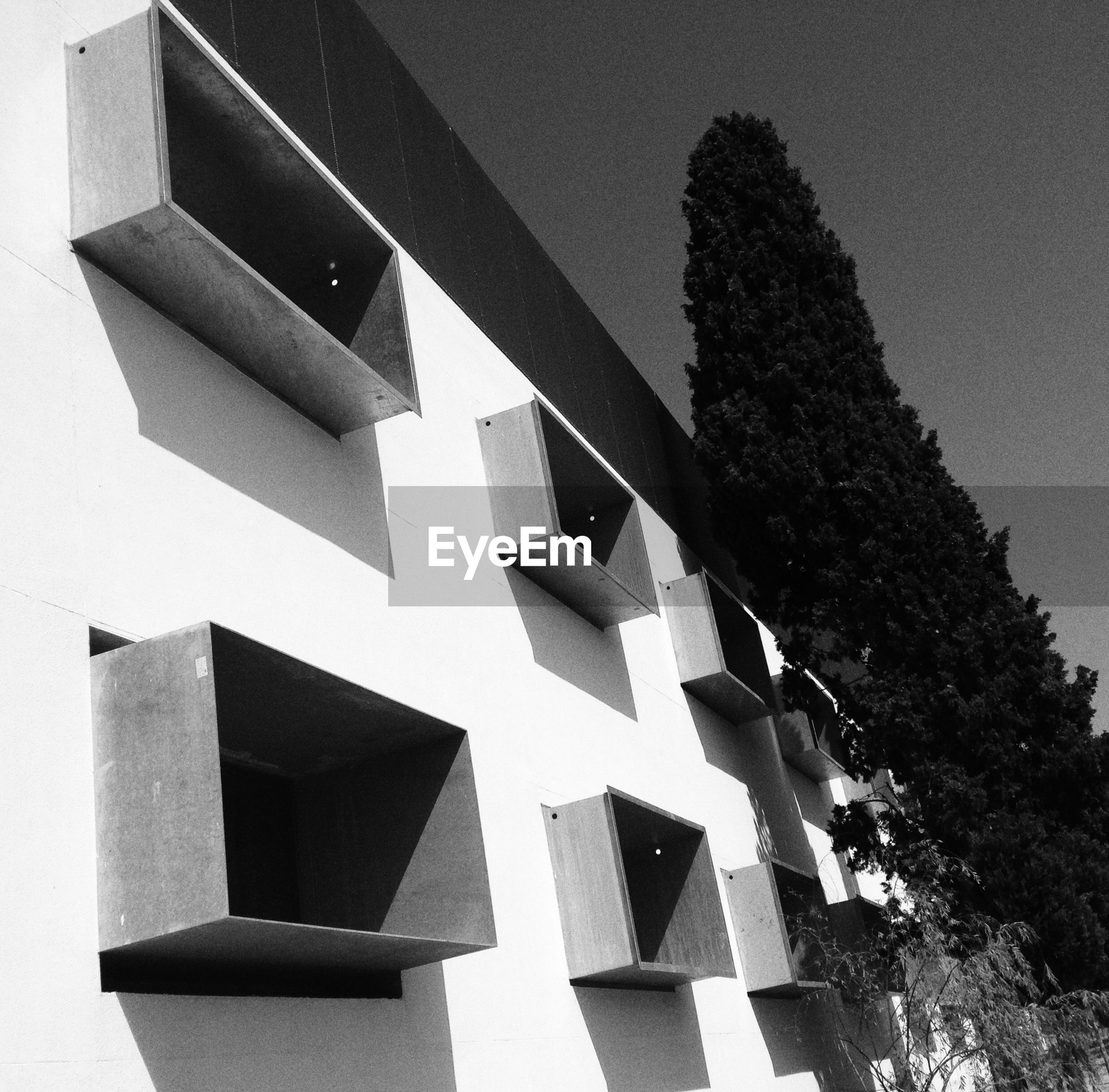 architecture, built structure, low angle view, shadow, building exterior, sunlight, art and craft, no people, art, day, pattern, creativity, shape, outdoors, human representation, geometric shape, auto post production filter, close-up, design