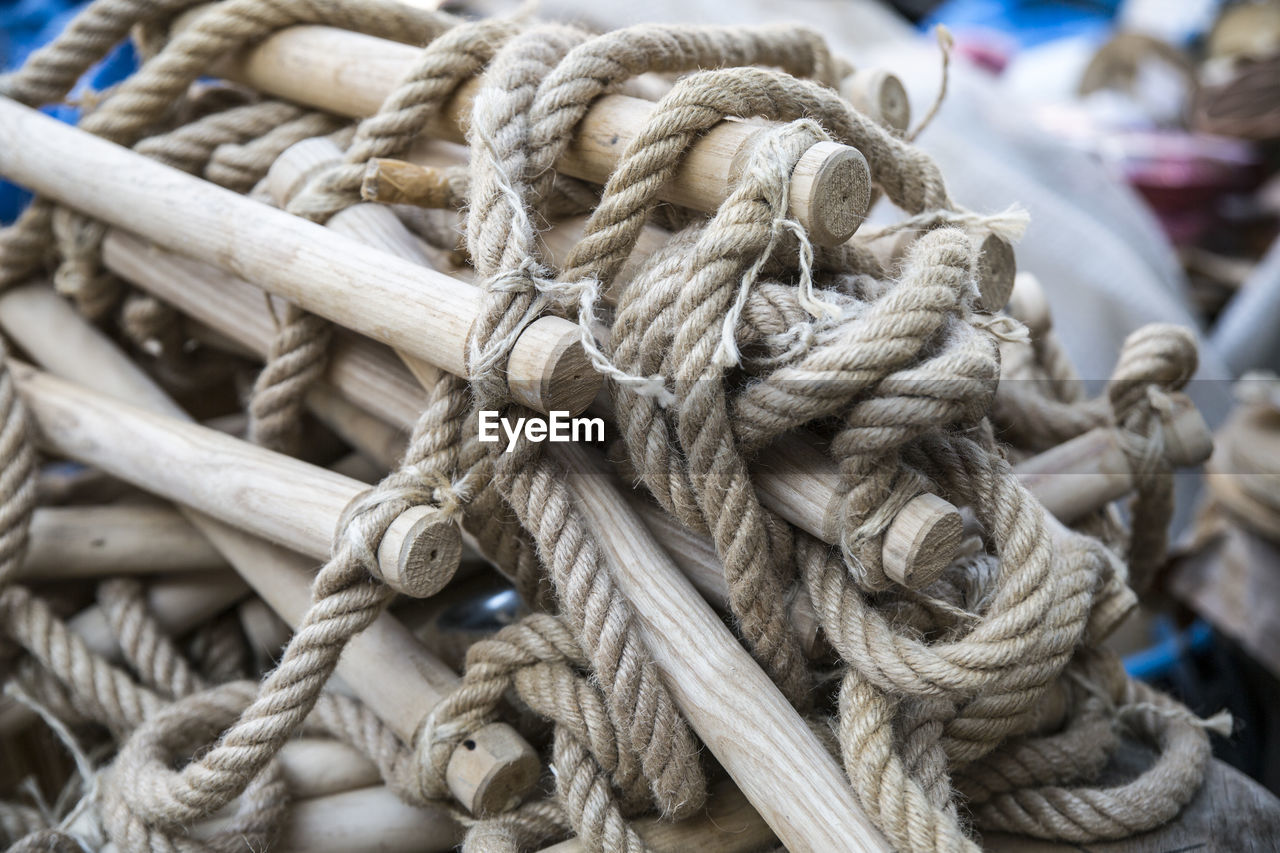 strength, rope, tied up, close-up, no people, tied knot, connection, day, durability, focus on foreground, transportation, textured, tangled, still life, pattern, complexity, outdoors, nautical vessel, detail, string, fishing industry