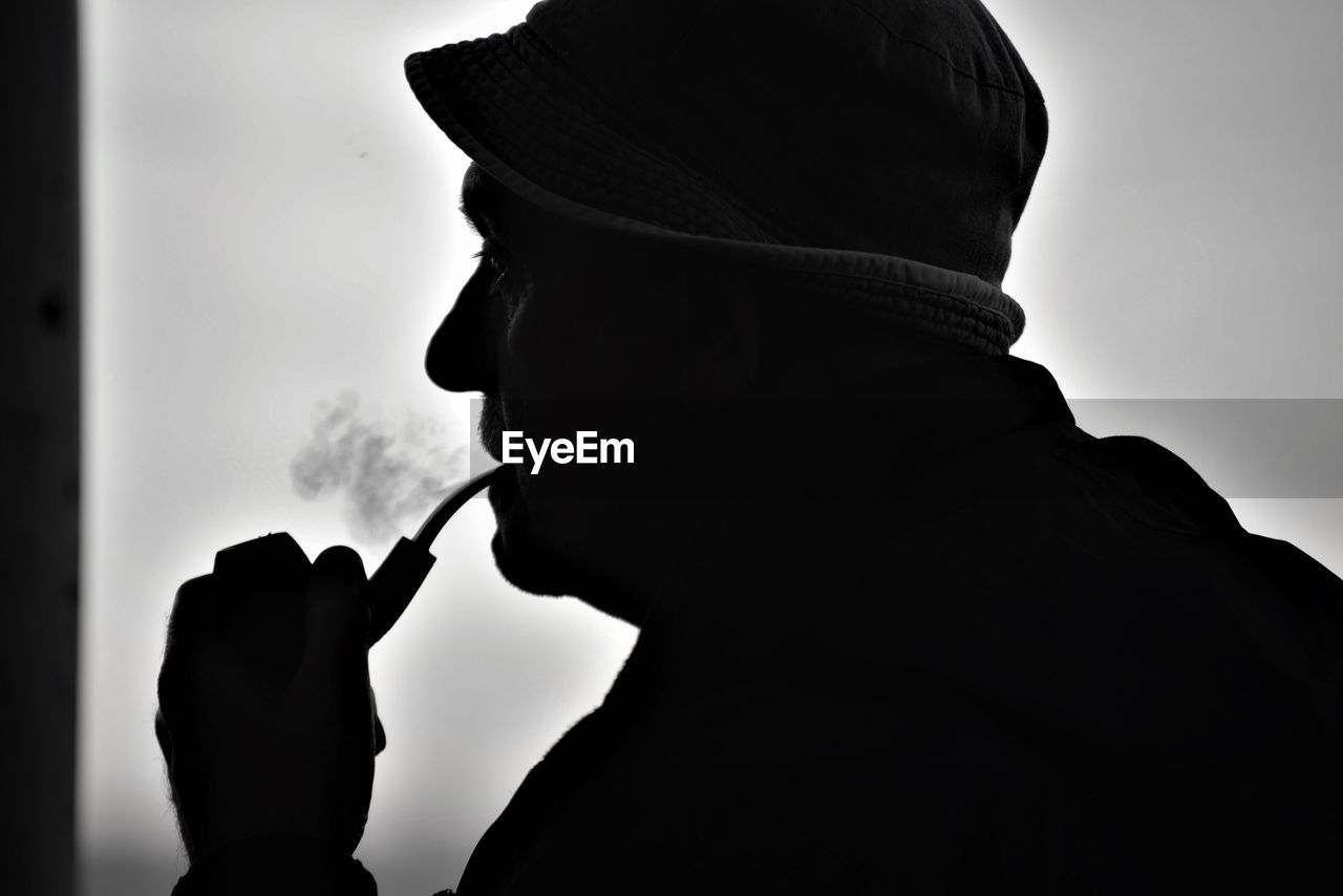 headshot, one person, real people, social issues, lifestyles, bad habit, side view, holding, smoking issues, leisure activity, men, cigarette, activity, smoking - activity, smoke - physical structure, clothing, portrait, close-up