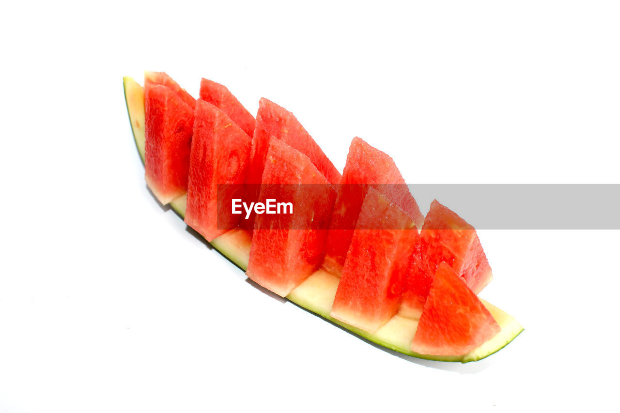 studio shot, white background, fruit, slice, healthy eating, watermelon, food, wellbeing, food and drink, freshness, red, close-up, indoors, still life, no people, cut out, copy space, juicy, melon, cross section, ripe, chopped, snack