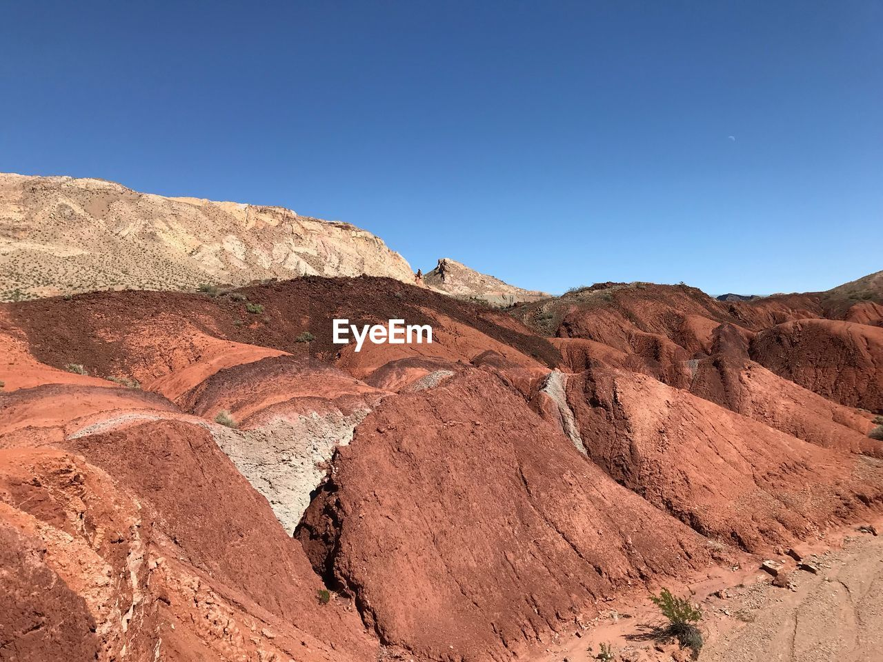 nature, clear sky, arid climate, desert, tranquility, tranquil scene, geology, landscape, scenics, day, beauty in nature, outdoors, rock - object, physical geography, mountain, no people, sunlight, travel destinations, blue, sky