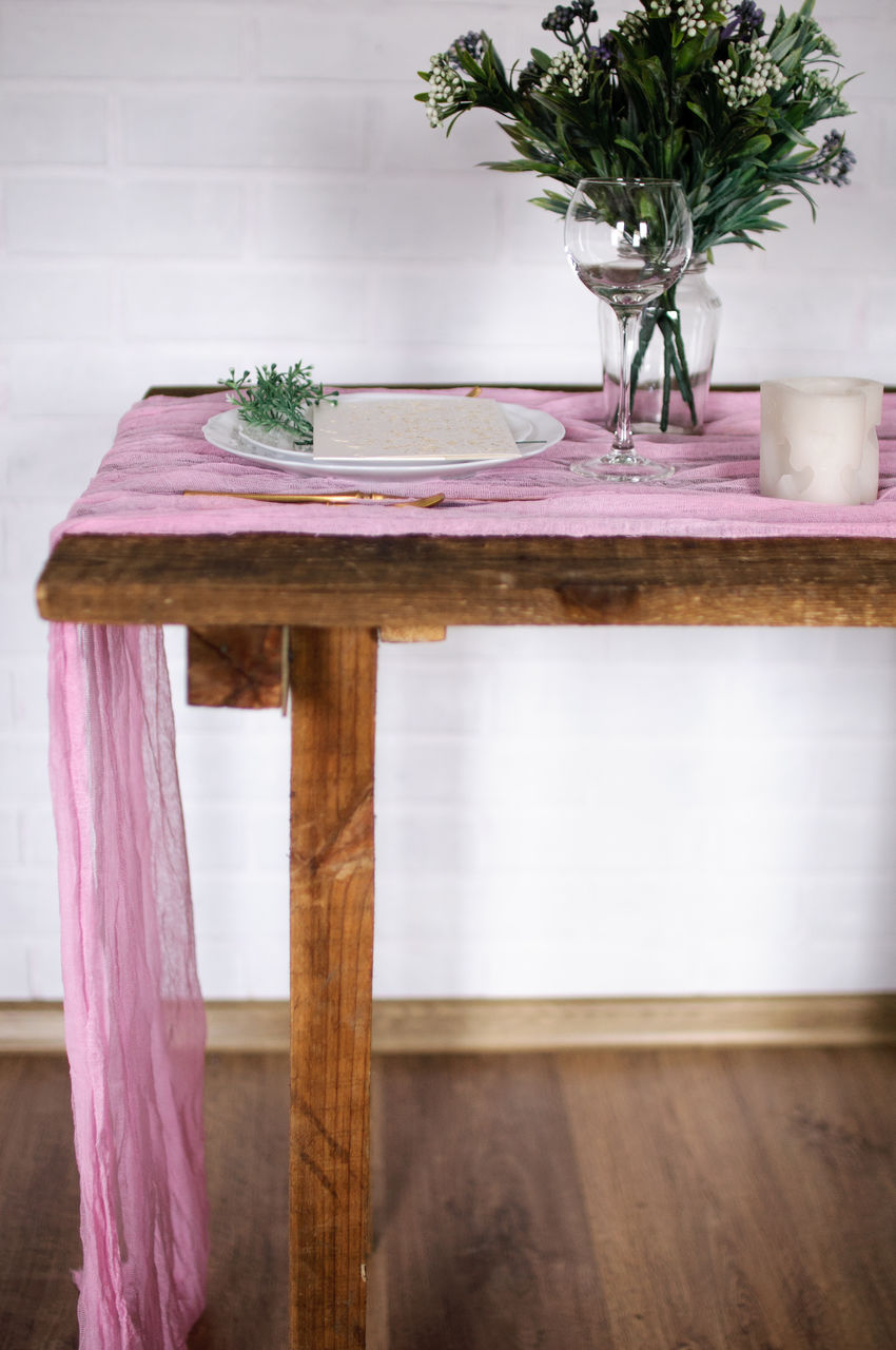POTTED PLANT ON TABLE BY WOODEN CHAIR AT HOME