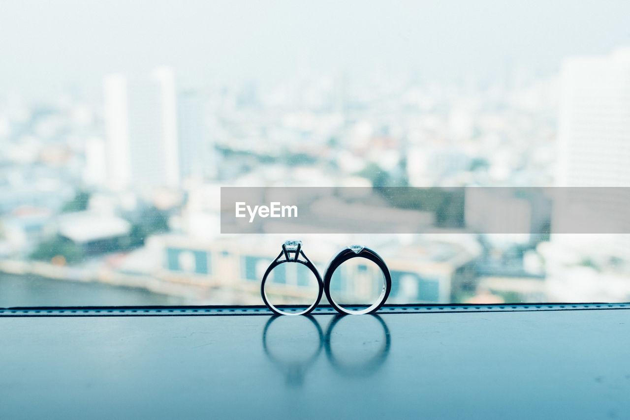 Close-Up Of Wedding Rings On Window