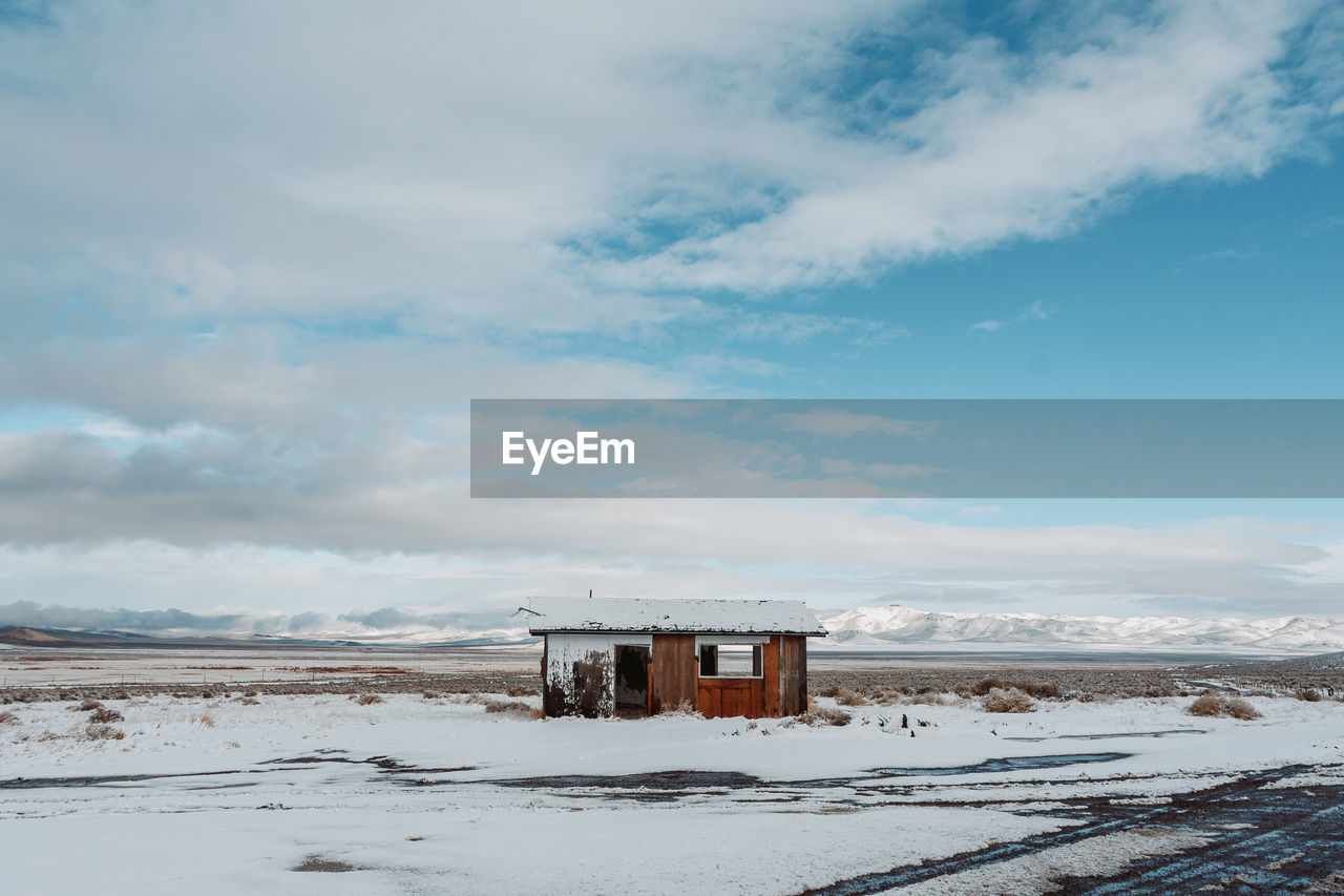 sky, winter, cloud - sky, snow, cold temperature, architecture, built structure, land, building exterior, nature, day, beauty in nature, scenics - nature, building, no people, beach, water, hut, outdoors